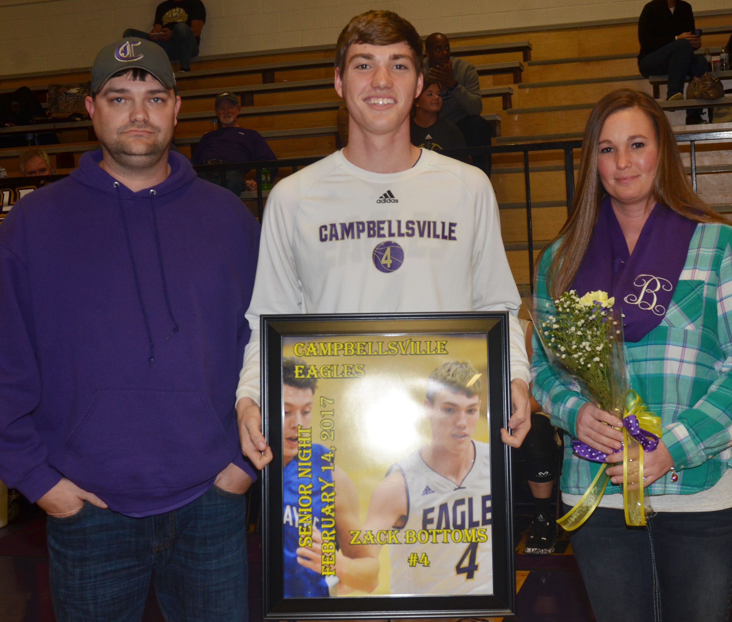 CHS senior boys' basketball player Zack Bottoms is honored. He is pictured with his parents, Adam and Kecia Bottoms.