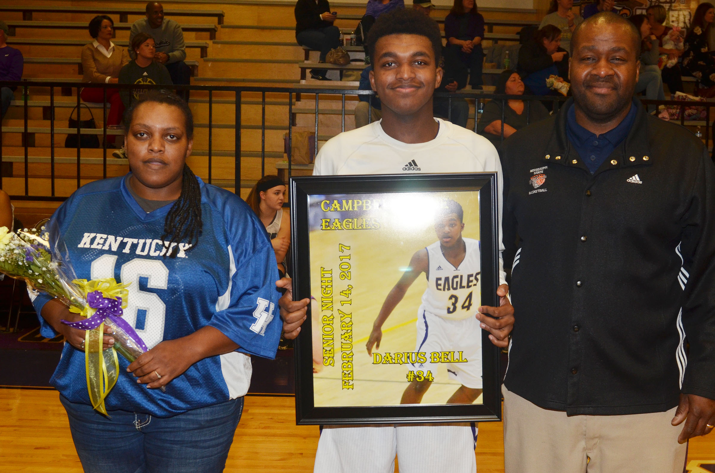 CHS senior boys' basketball player Darius Bell is honored. He is pictured with his parents, Jeanetta Smith and Anthony Bell.
