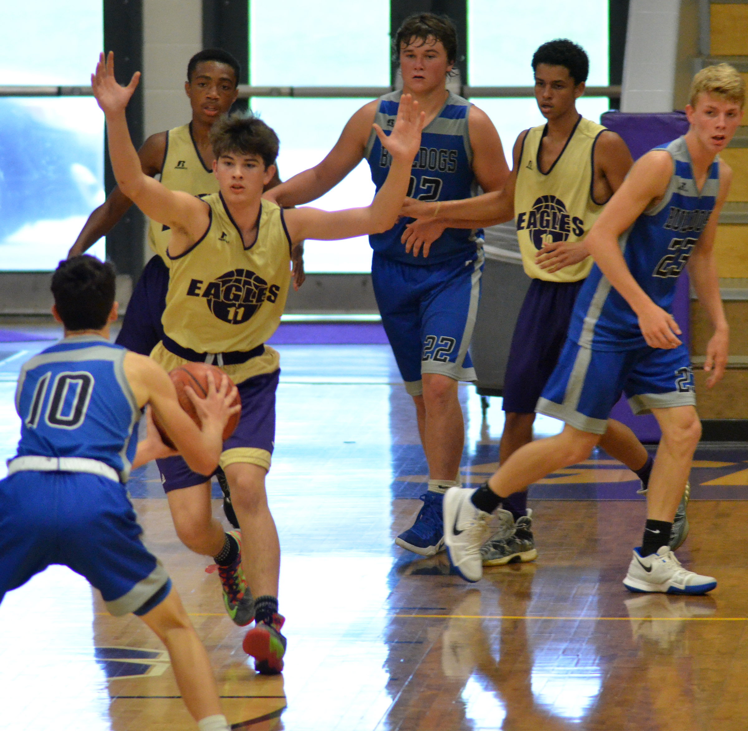 CHS sophomore Mark Rigsby plays defense, with teammates Lathan Cubit and Mikael Vaught, also sophomores, in back.