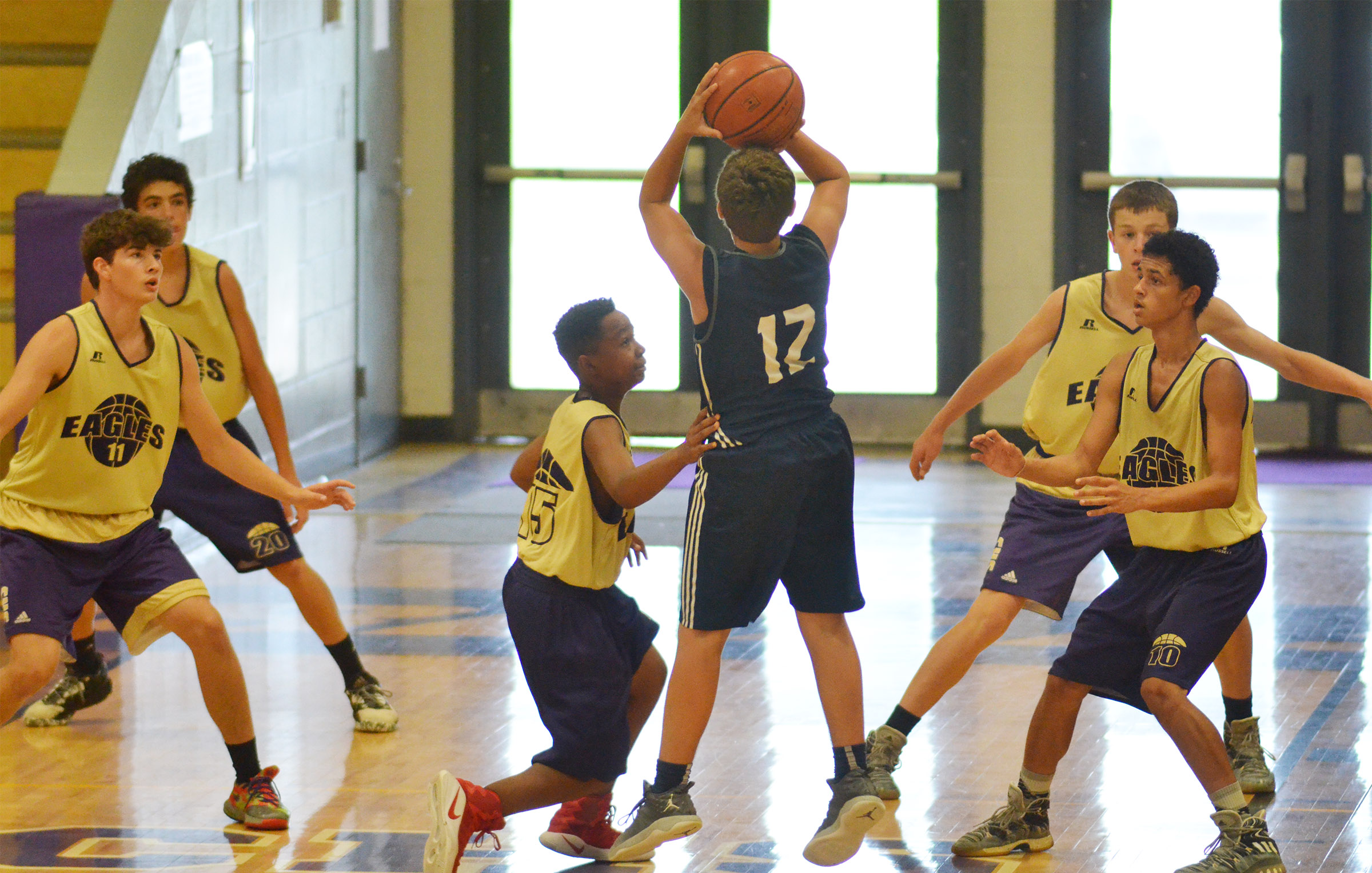 CHS players, from left, sophomore Mark Rigsby, freshman Kameron Smith, sixth-grader Deondre Weathers and sophomores Noah Hughes and Mikael Vaught play defense.