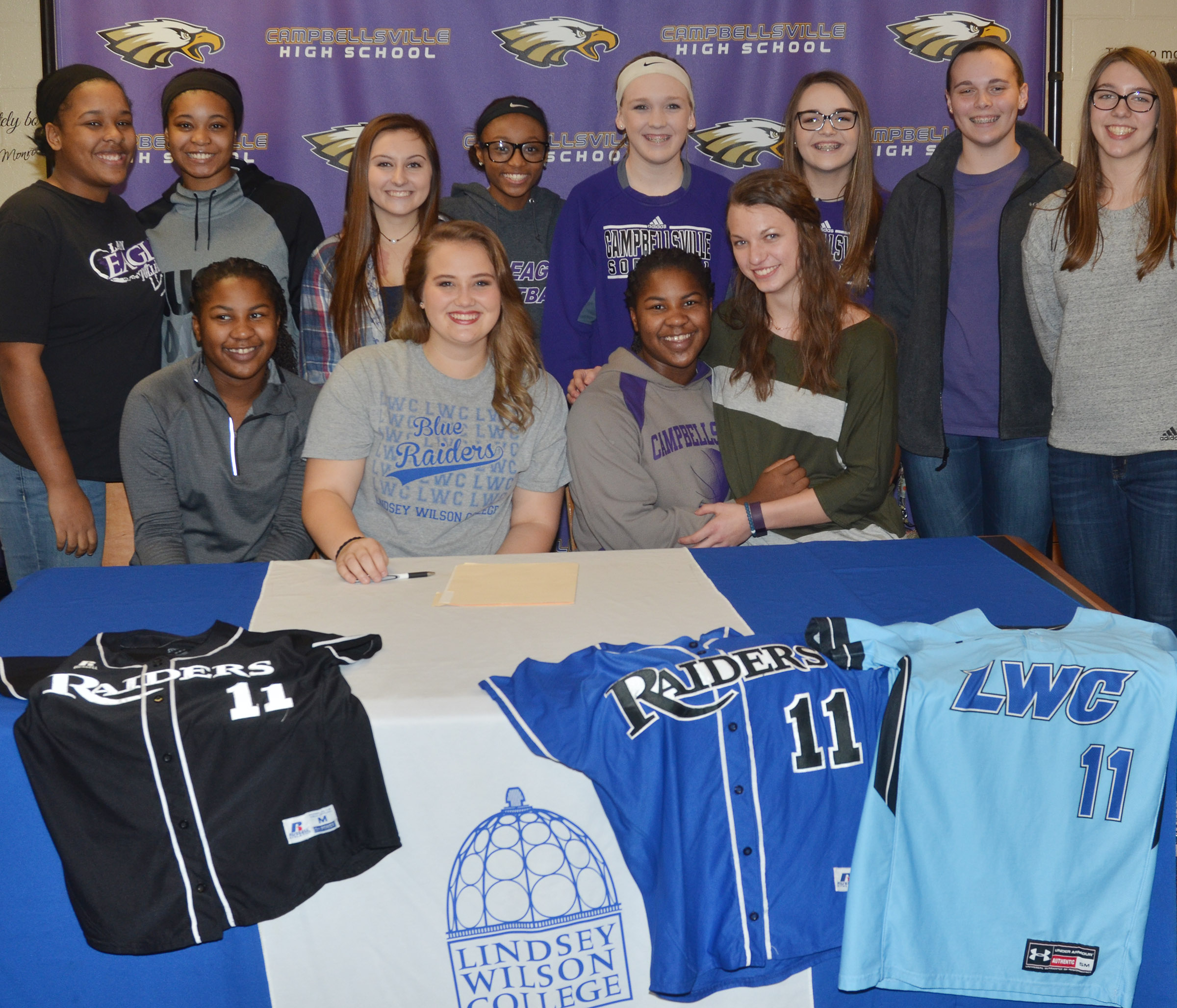 CHS senior Brenna Wethington has signed to continue her softball career at Lindsey Wilson College. She is pictured with her CHS girls' basketball teammates. From left, front, are junior Nena Barnett, Wethington, junior Kiyah Barnett and senior Caylie Blair. Back, juniors Kayla Young and Vonnea Smith, sophomore Reagan Knight, Campbellsville Middle School seventh-grader Bri Gowdy, CMS eighth-graders Catlyn Clausen and Kenzi Forbis, freshman Katelyn Miller and CMS eighth-grader Abi Wiedewitsch.