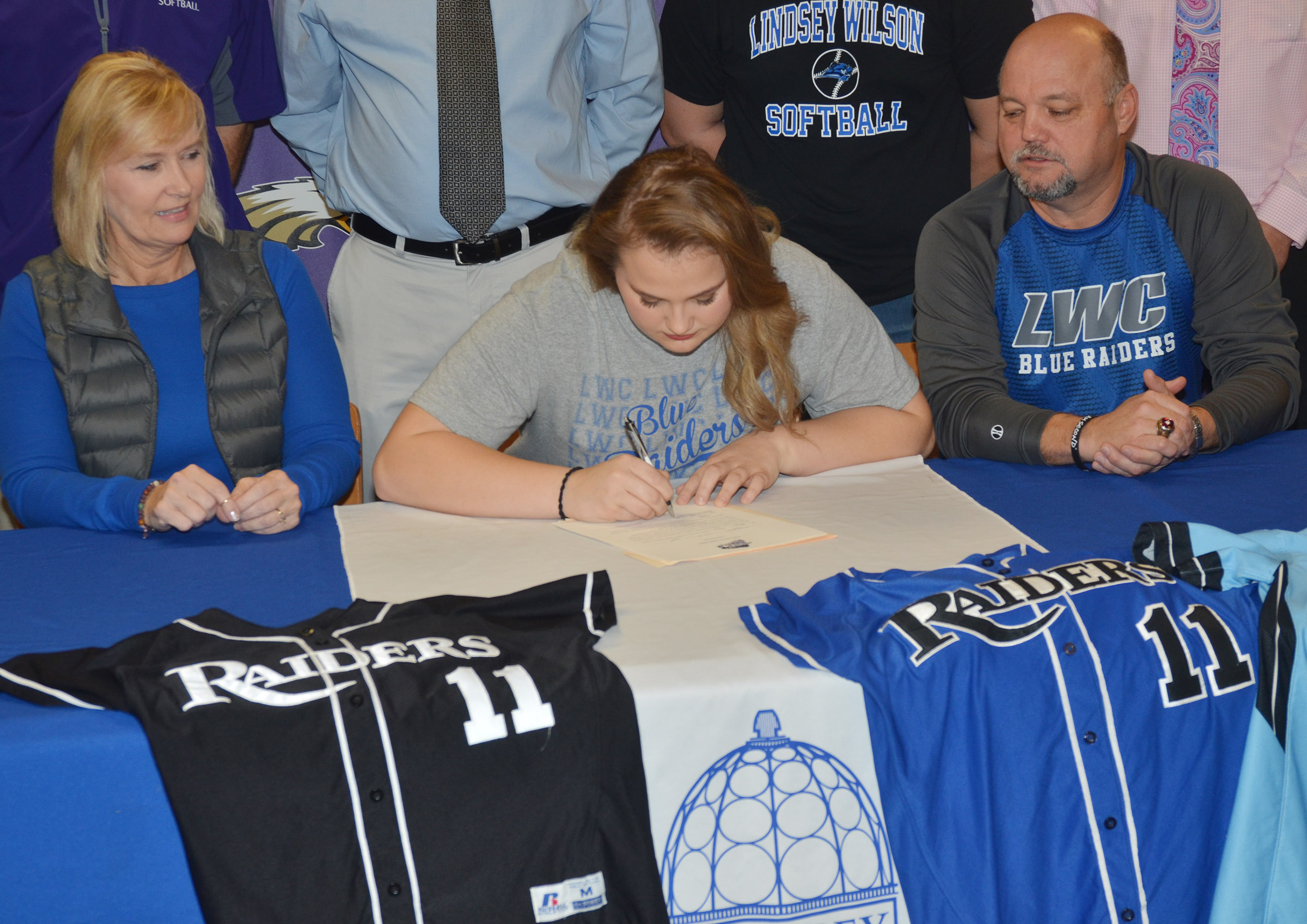 CHS senior Brenna Wethington has signed to continue her softball career at Lindsey Wilson College. She is pictured with her parents, Sheila and John Wethington.