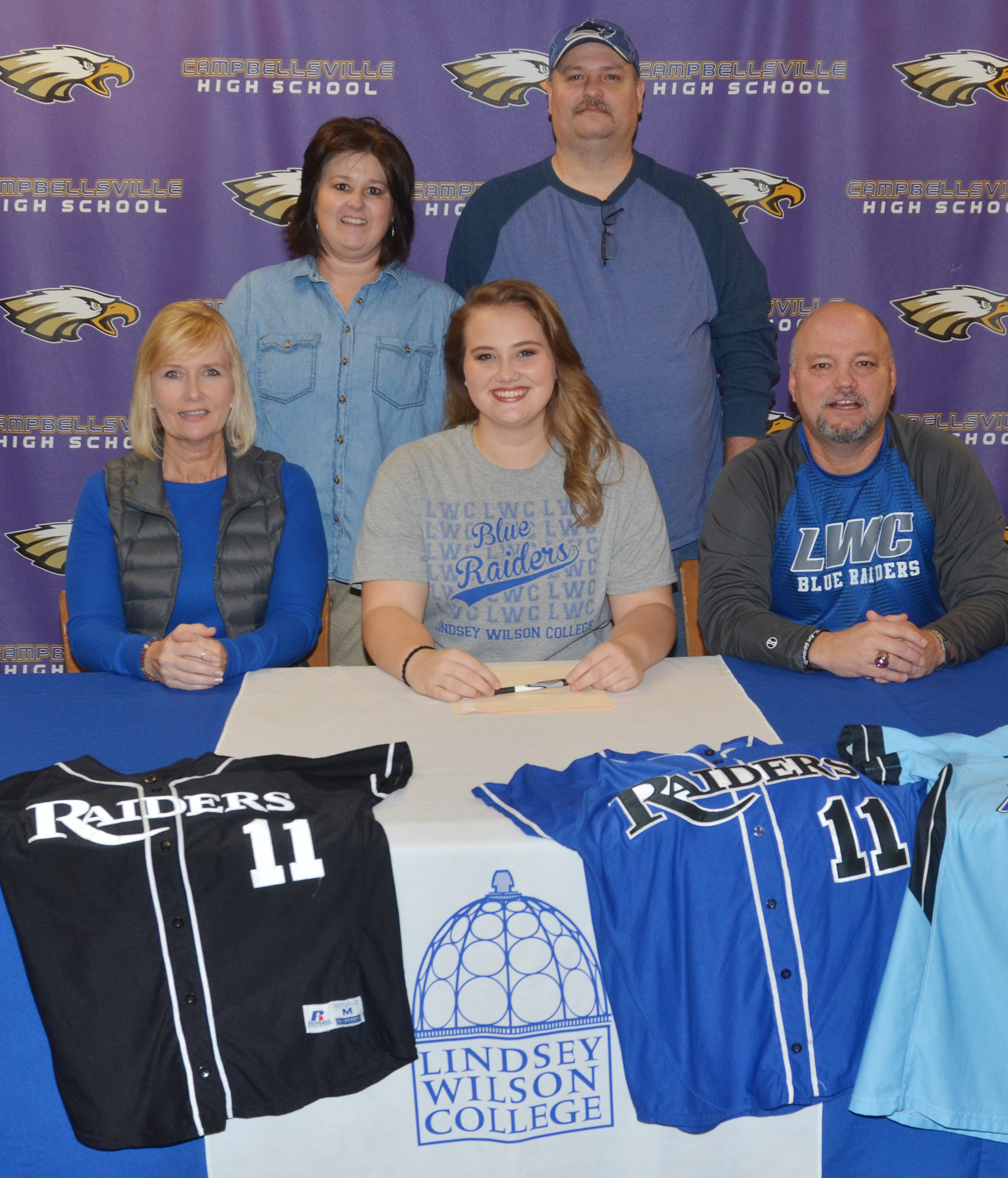 CHS senior Brenna Wethington has signed to continue her softball career at Lindsey Wilson College. She is pictured with her parents, Sheila and John Wethington and Campbellsville Board of Education member Suzanne Wilson and her husband, Daren.