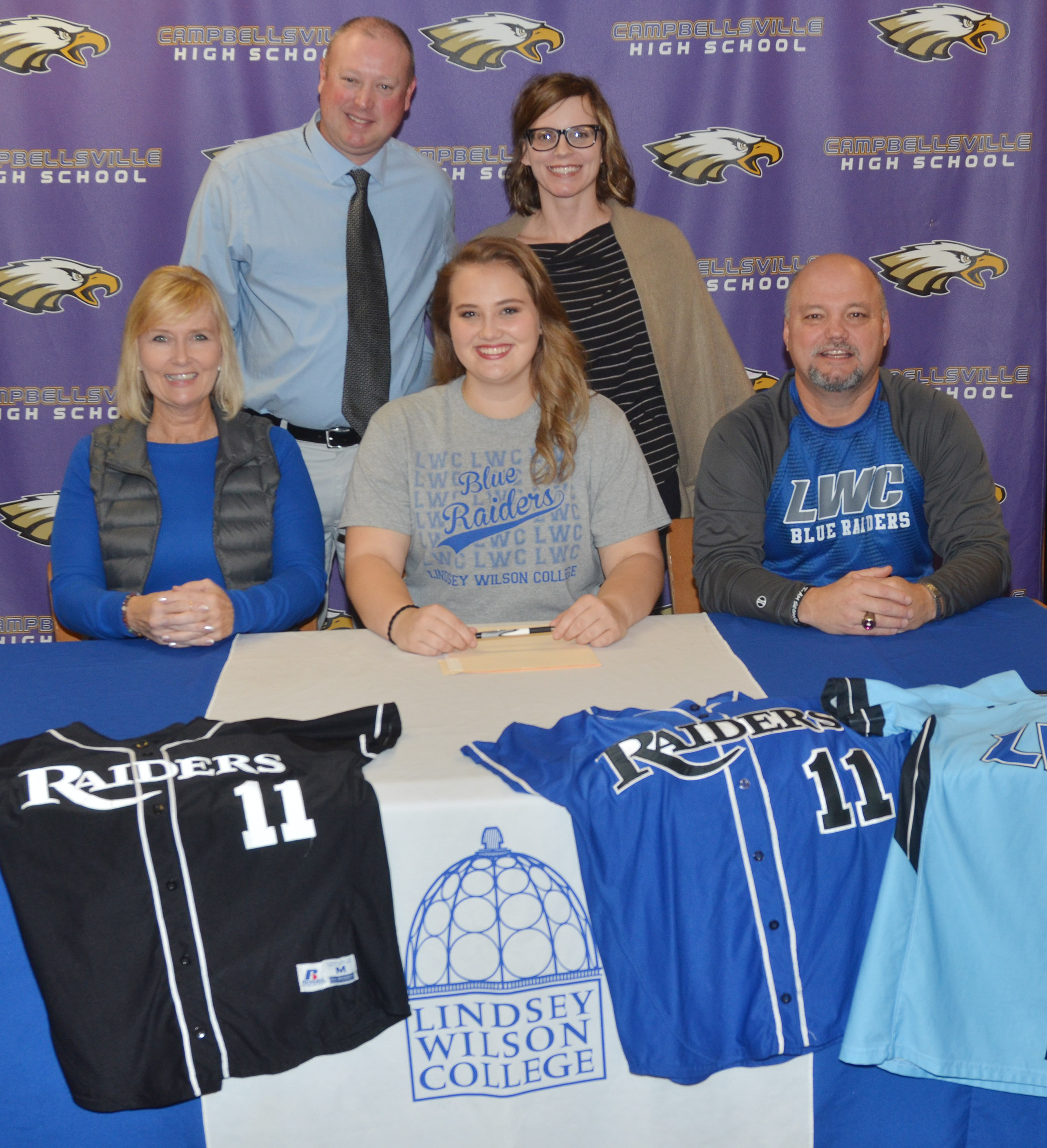 CHS senior Brenna Wethington has signed to continue her softball career at Lindsey Wilson College. She is pictured with her parents, Sheila and John Wethington. Back, LWC head softball coach David Dews and LWC Director of Admissions Charity Ferguson.