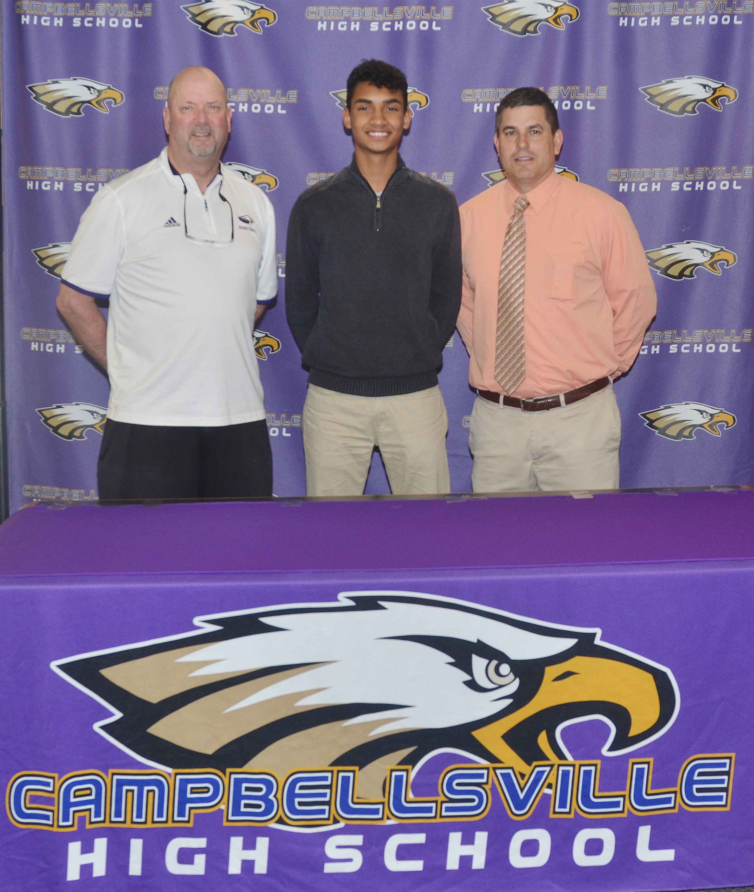 Campbellsville High School soccer player Daniel Silva will continue his academic and athletic career at Campbellsville University. Silva recently signed his letter of intent in a special ceremony with friends, family members, classmates and teammates. From left are CHS Athletic Director Tim Davis, Silva and CHS Principal Kirby Smith.