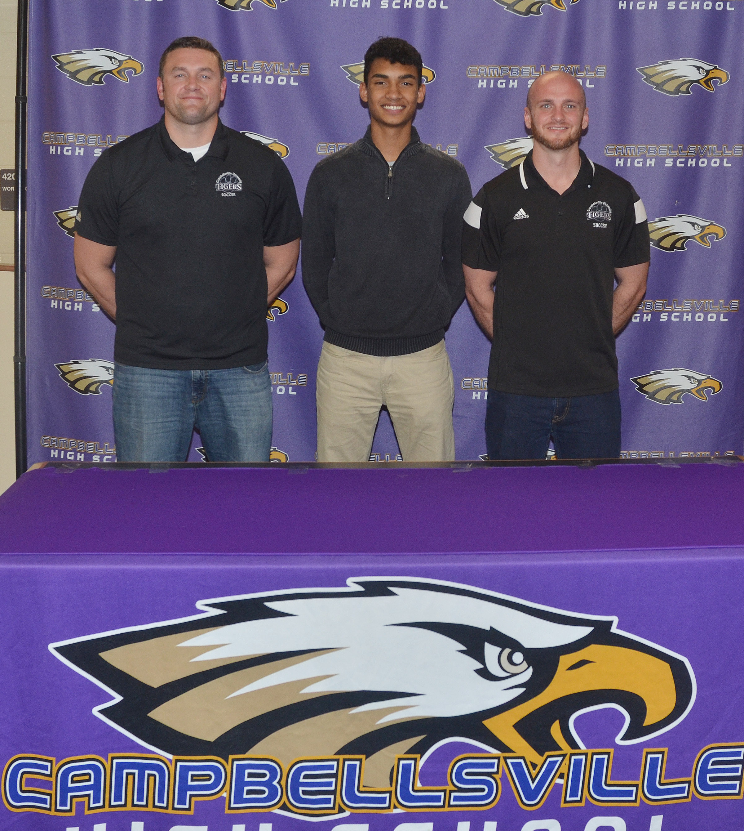 Campbellsville High School soccer player Daniel Silva will continue his academic and athletic career at Campbellsville University. Silva recently signed his letter of intent in a special ceremony with friends, family members, classmates and teammates. From left are CU head soccer coach Adam Preston, Silva and assistant coach Alex Adams.