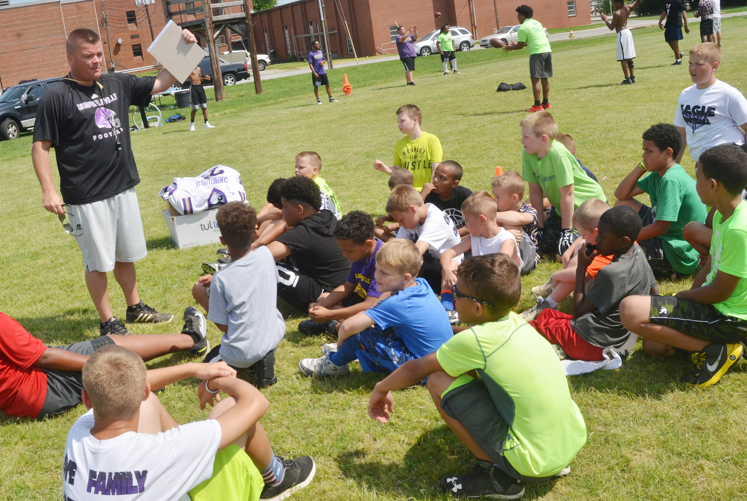 CHS head football coach Dale Estes talks to campers.