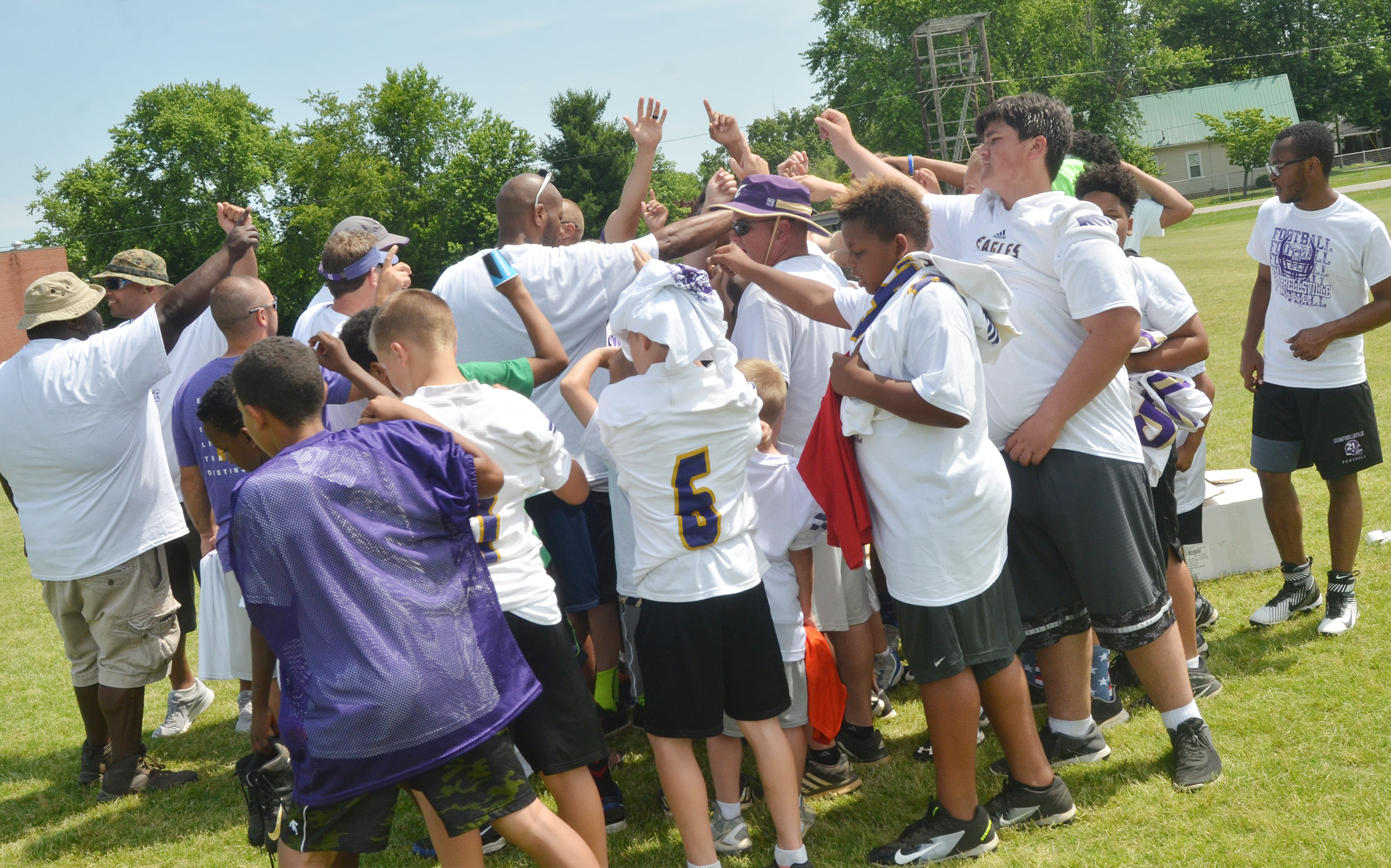 Eagle Football Camp participants cheer for the Eagles to end camp.