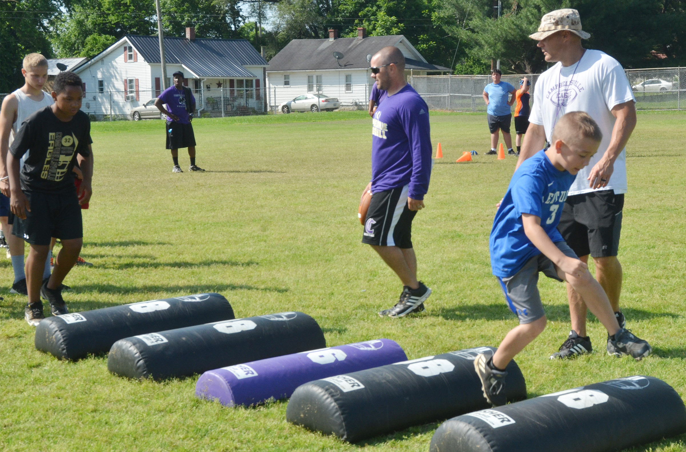 Cameron Estes works on his footwork with assistant coaches Blake Milby, at left, and Robbie Gribbins.