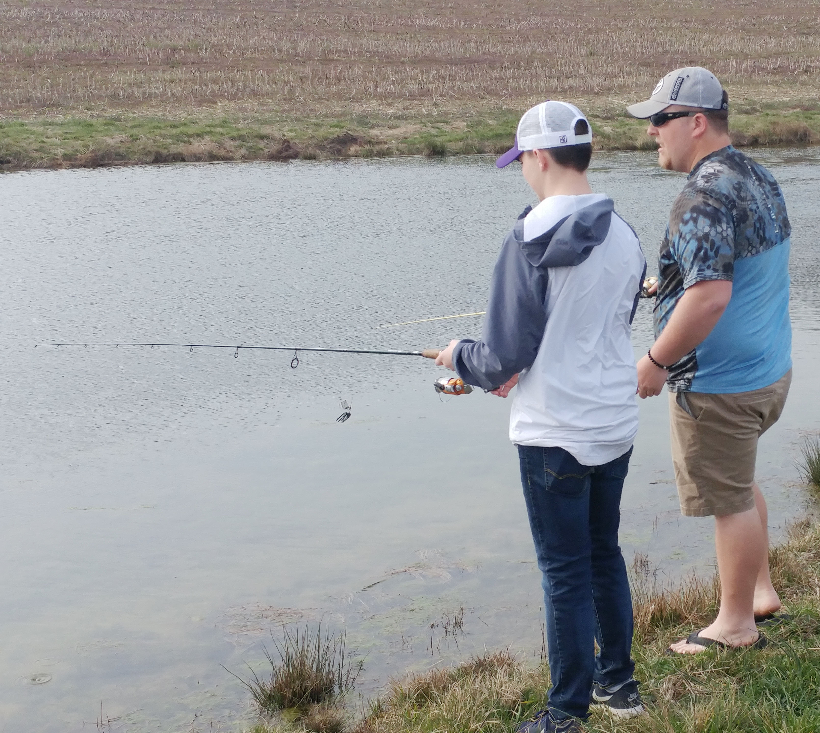 CHS freshman Cole Kidwell fishes with CU junior Dakota Cantrell.