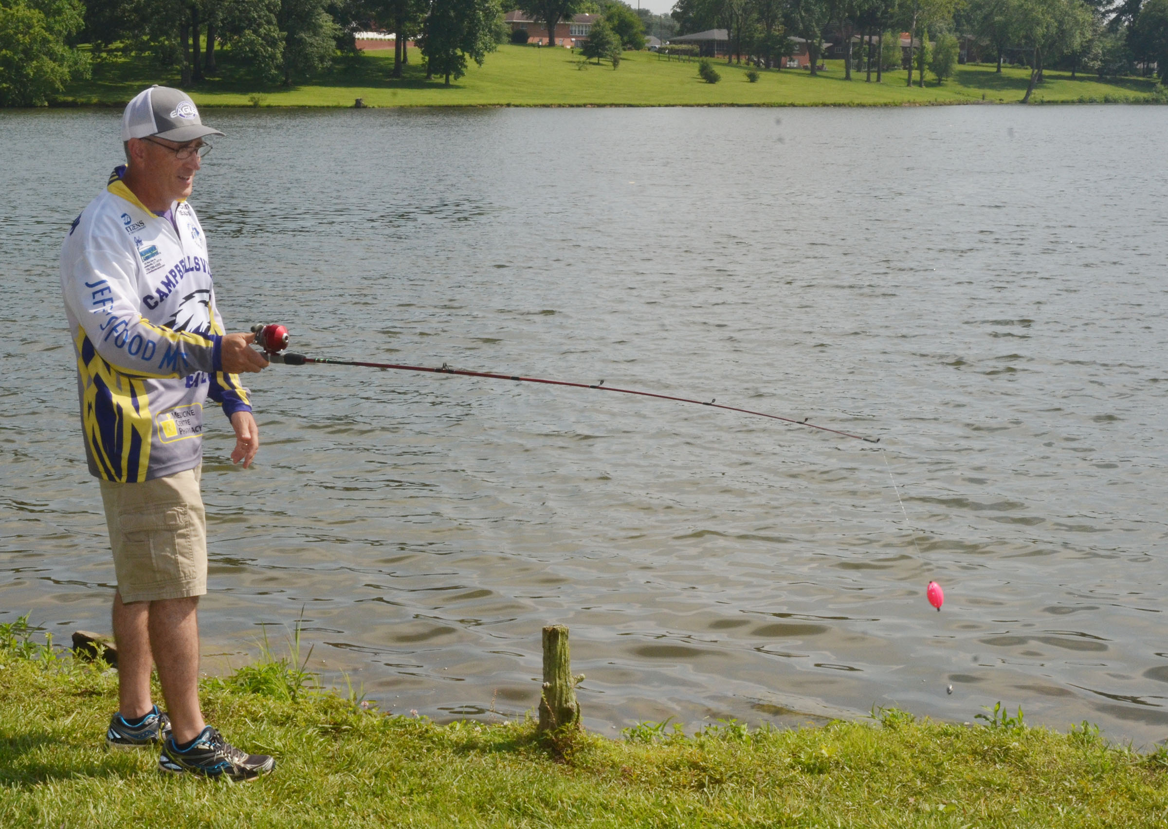 CHS fishing coach Jeff Richardson teaches how to cast.