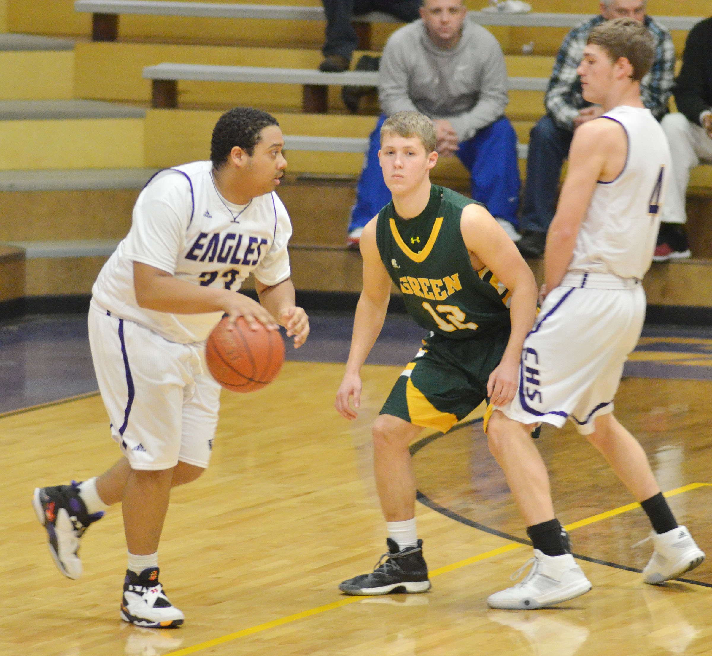 CHS senior Ricky Smith-Cecil dribbles to the basket as fellow senior Zack Bottoms plays defense.