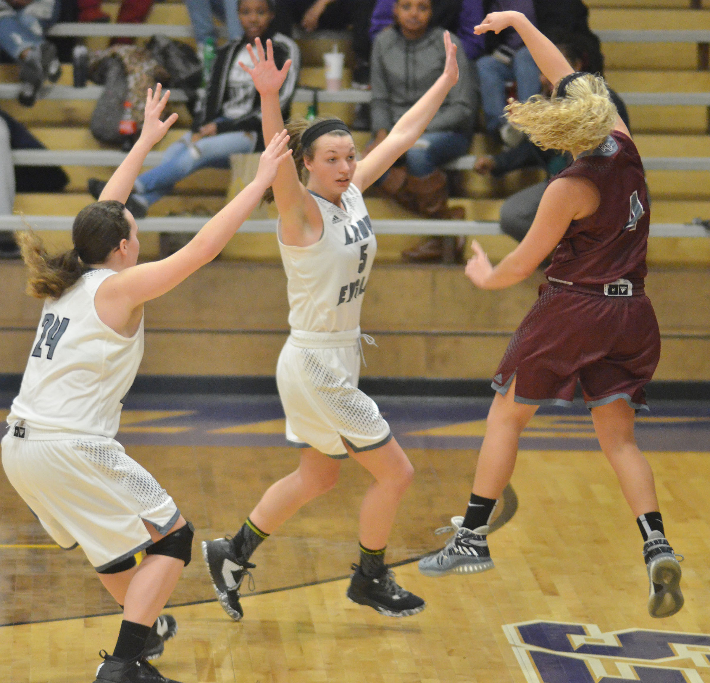 CHS freshman Katelyn Miller, at left, and senior Caylie Blair jump to block a shot.