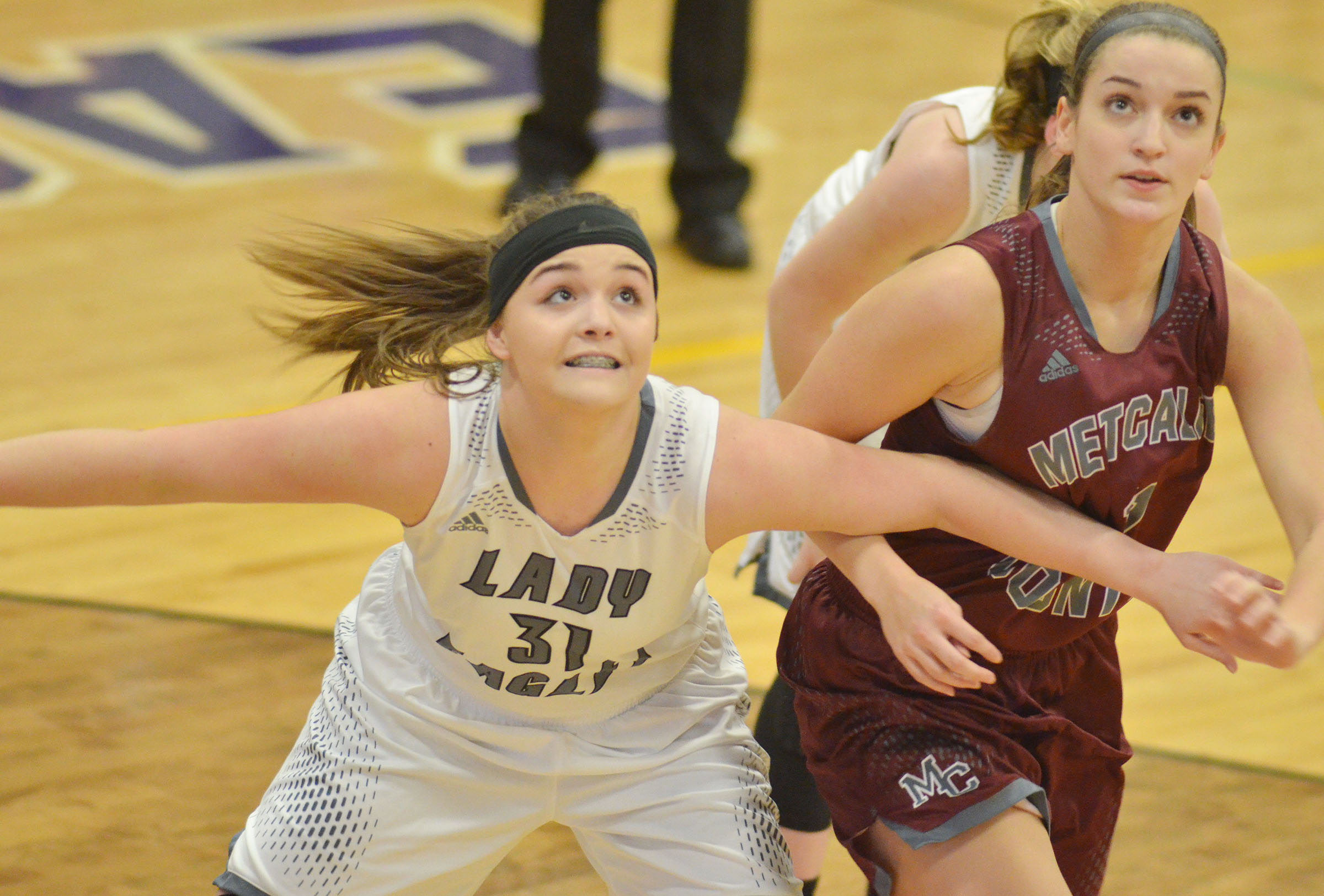 Campbellsville Middle School eighth-grader Kenzi Forbis looks for a rebound.