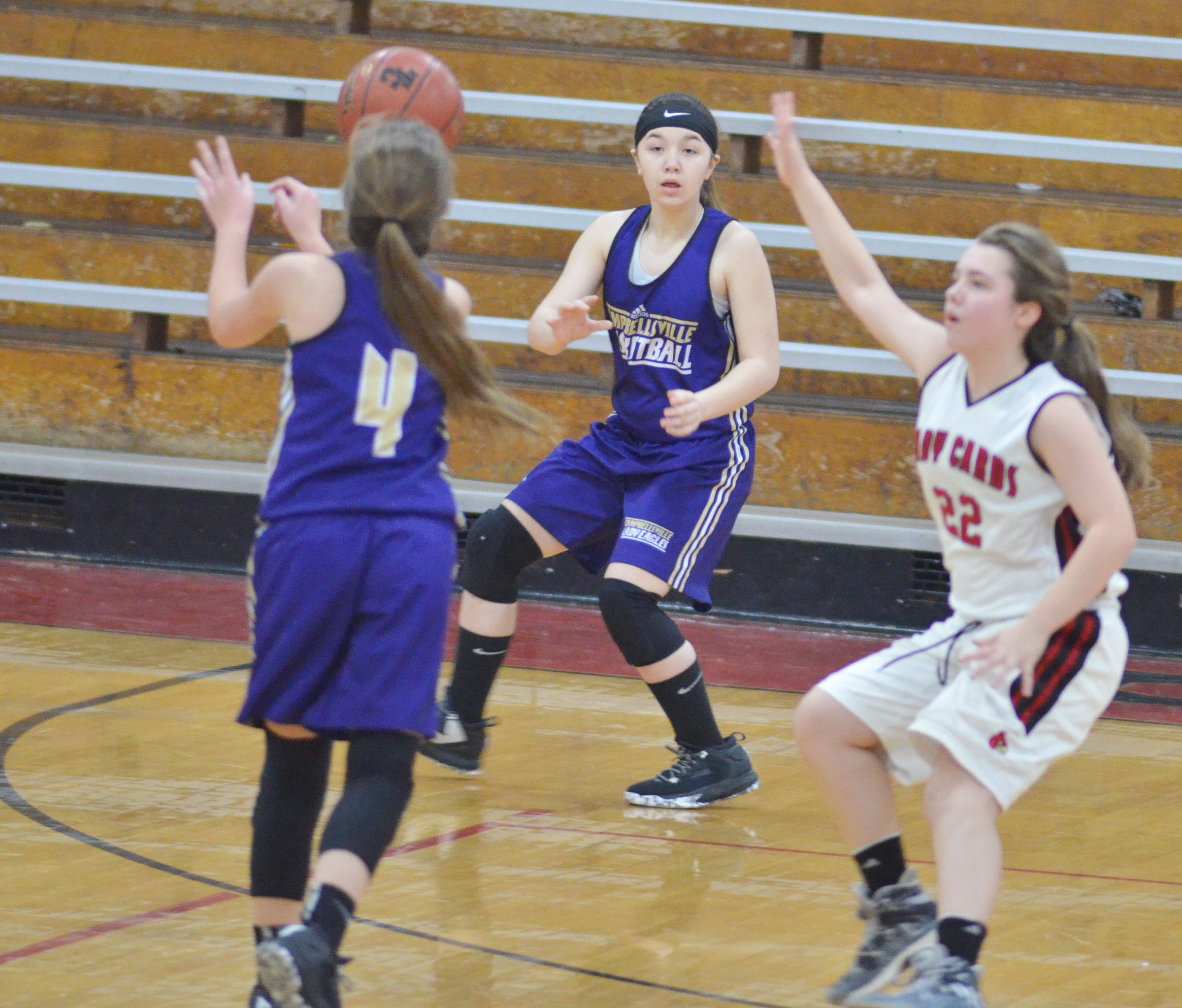 Campbellsville Middle School seventh-grader Olivia Fields catches the ball from teammate Lainey Watson, also a seventh-grader.