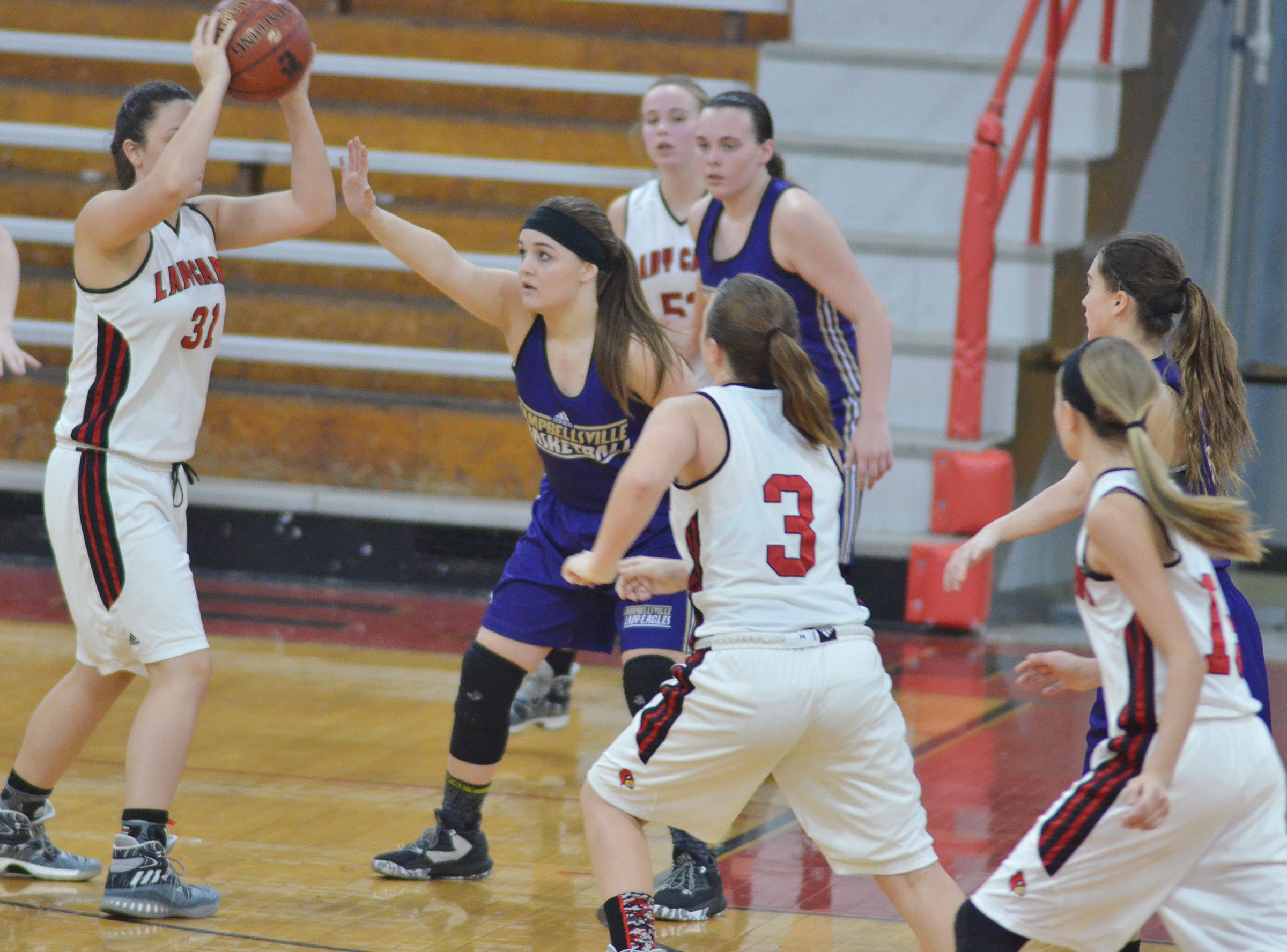 Campbellsville Middle School eighth-grader Kenzi Forbis plays defense.