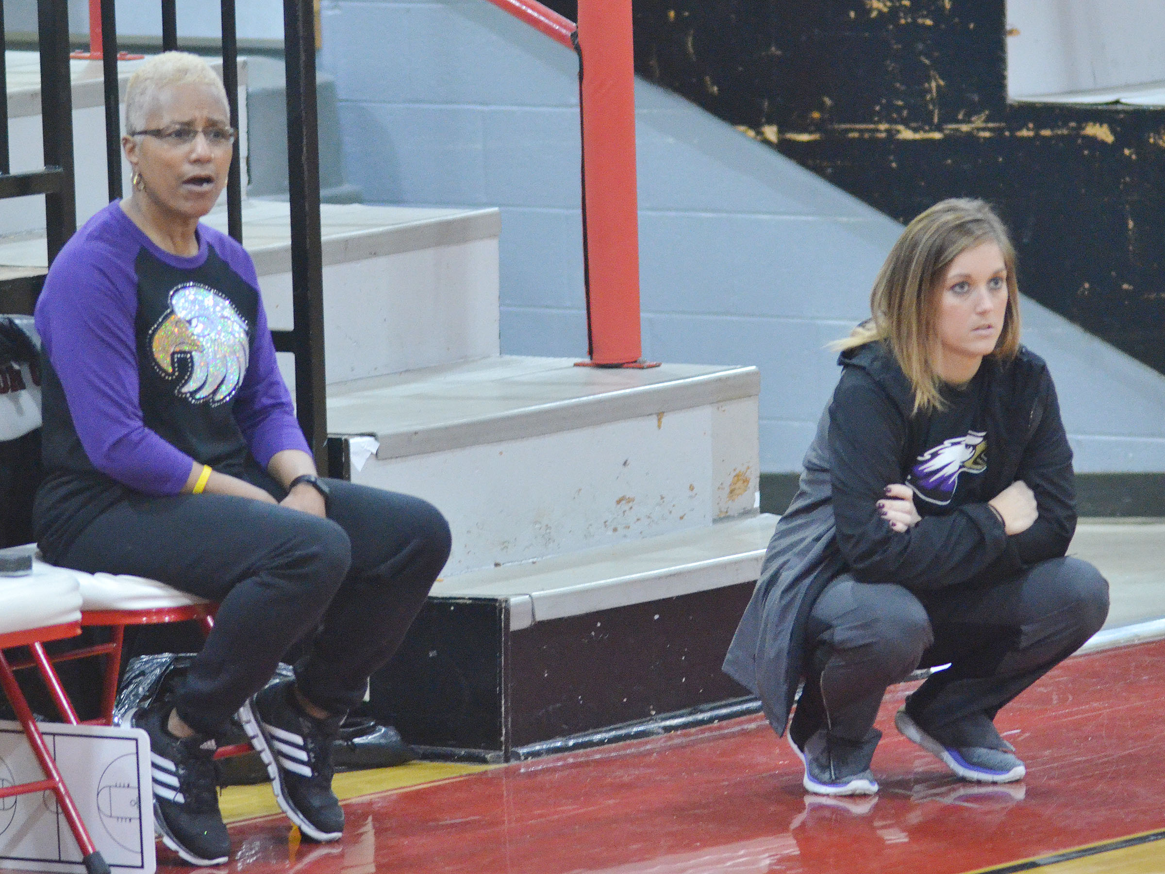 Assistant coaches Debbie Gowdy-Smith, at left, and Natalia Warren watch as their players take on Taylor County.