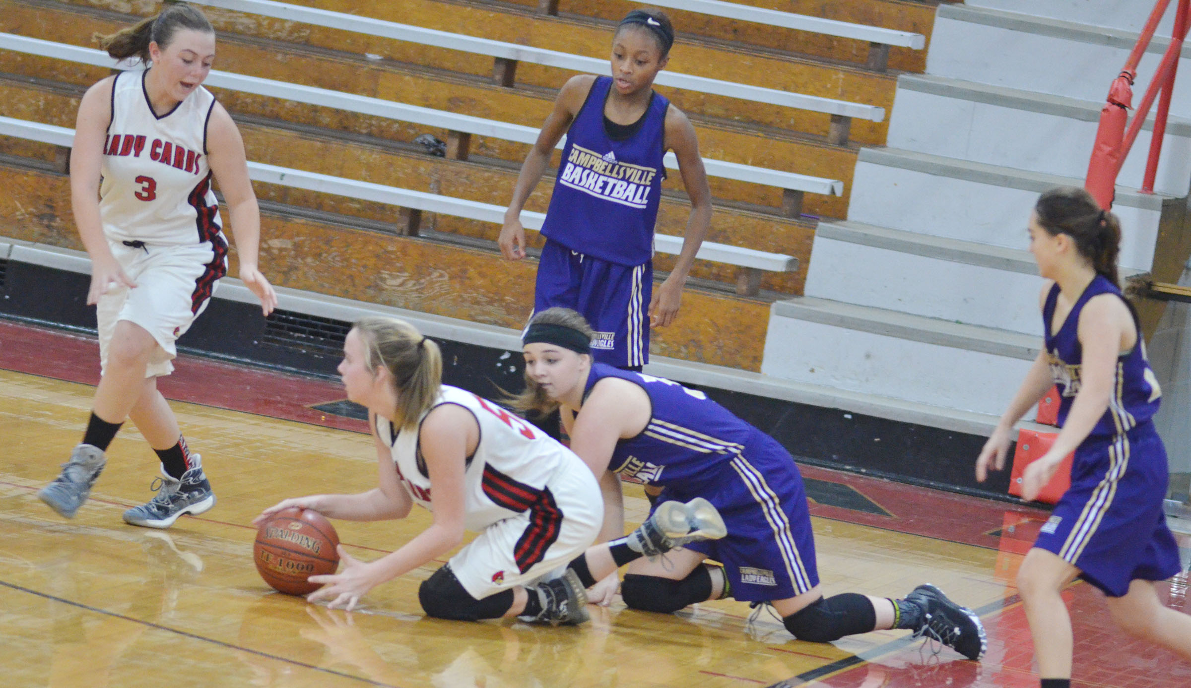 Campbellsville Middle School eighth-grader Kenzi Forbis battles for the ball.