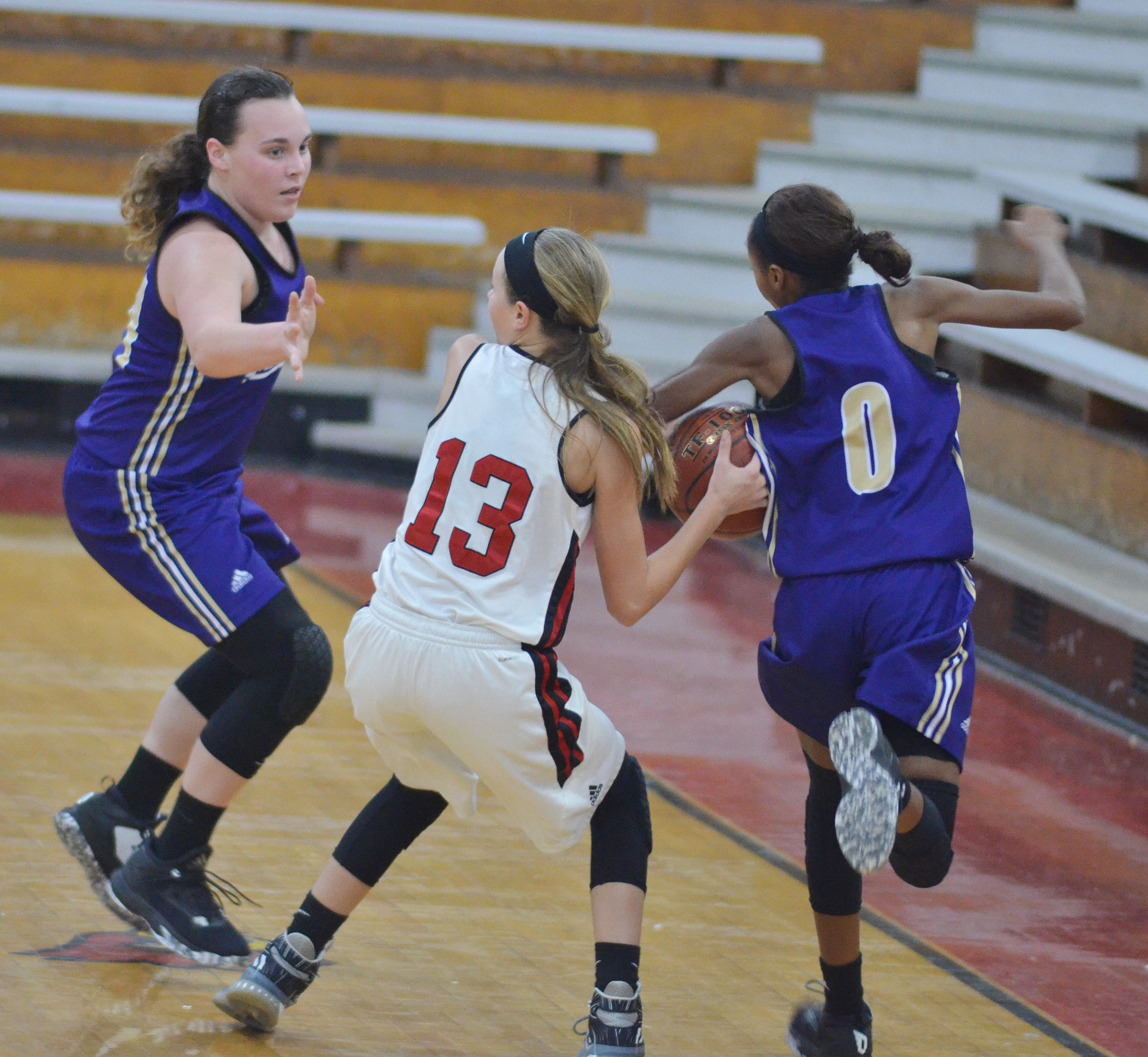 CHS freshman Katelyn Miller, at left, and Campbellsville Middle School seventh-grader Bri Gowdy play defense.