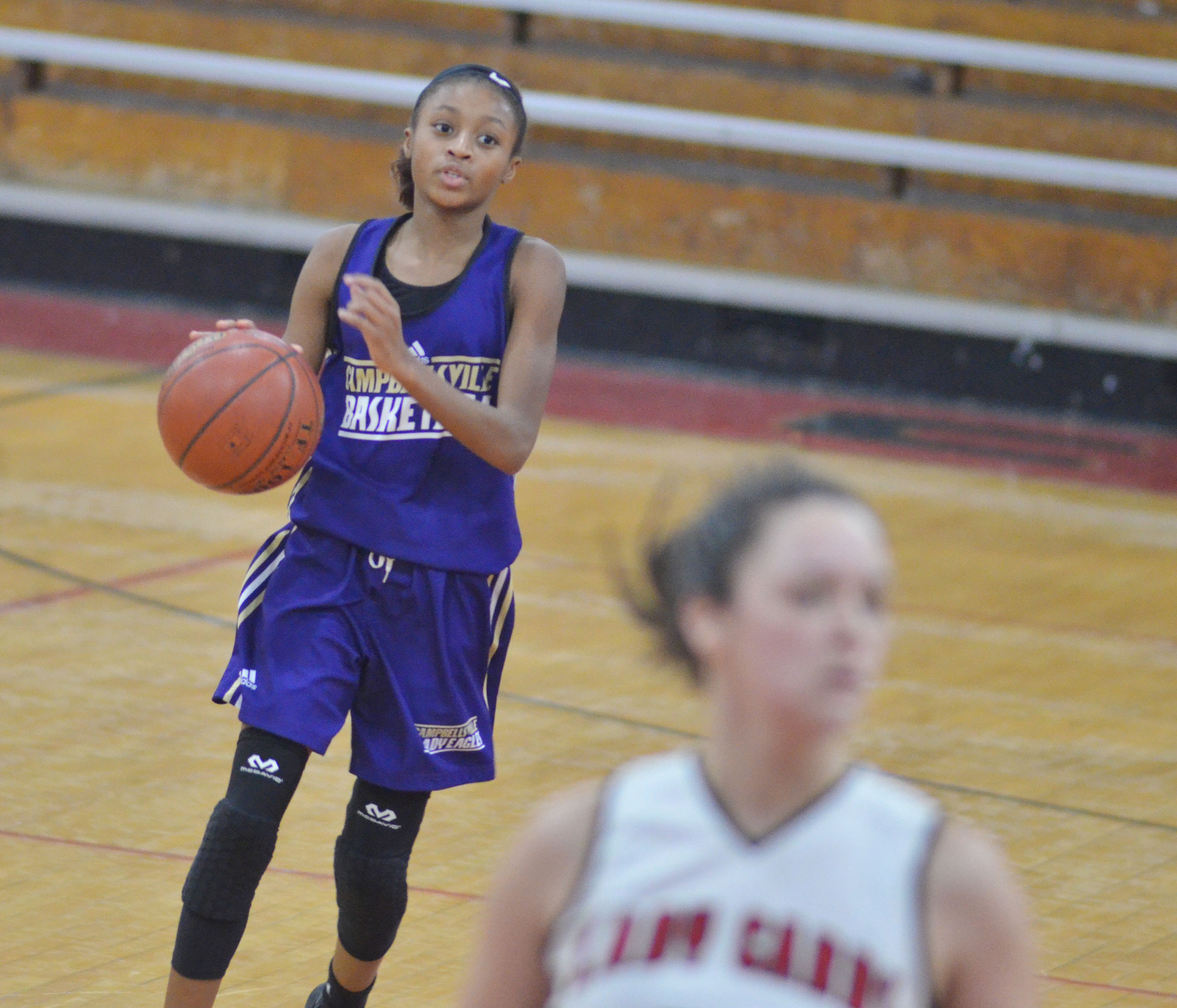 Campbellsville Middle School seventh-grader Bri Gowdy dribbles to the hoop.