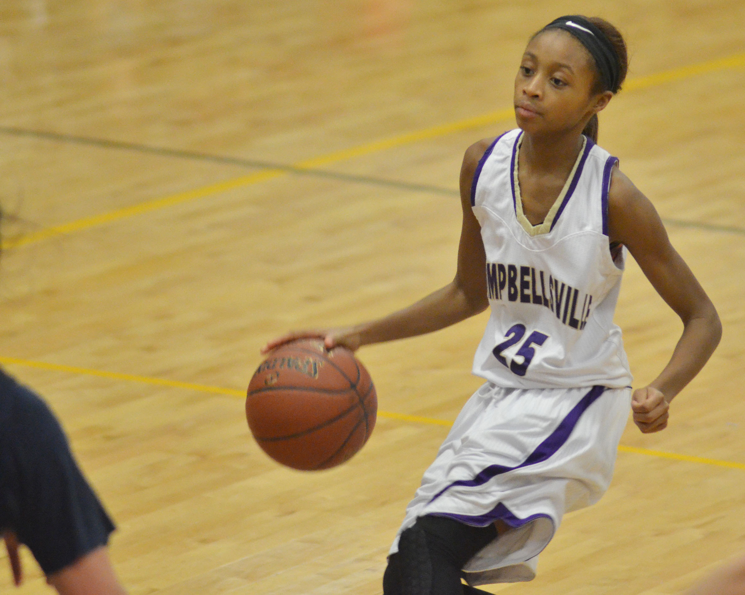 Campbellsville Middle School seventh-grader Bri Gowdy dribbles.