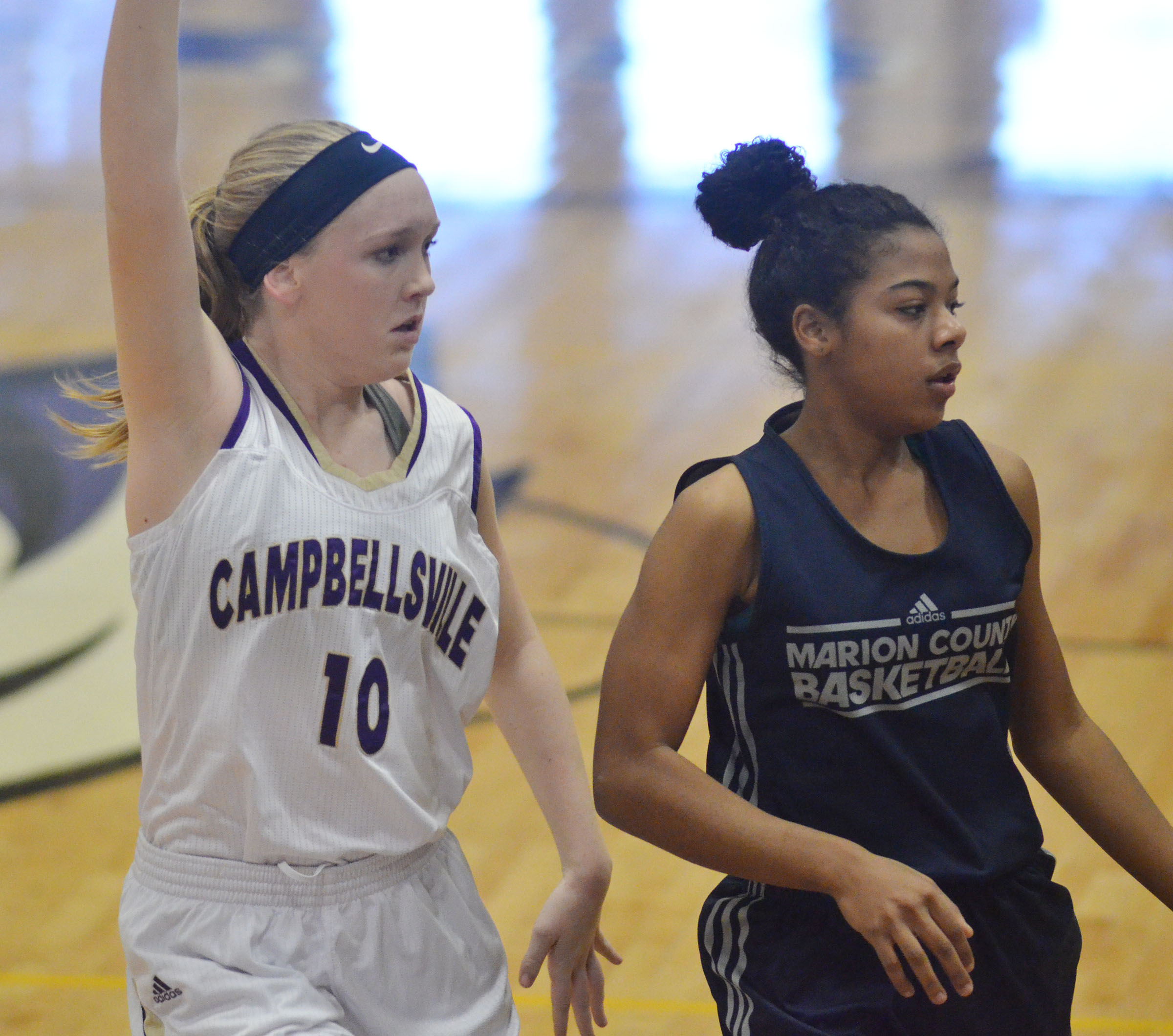Campbellsville Middle School eighth-grader Catlyn Clausen calls for the ball.