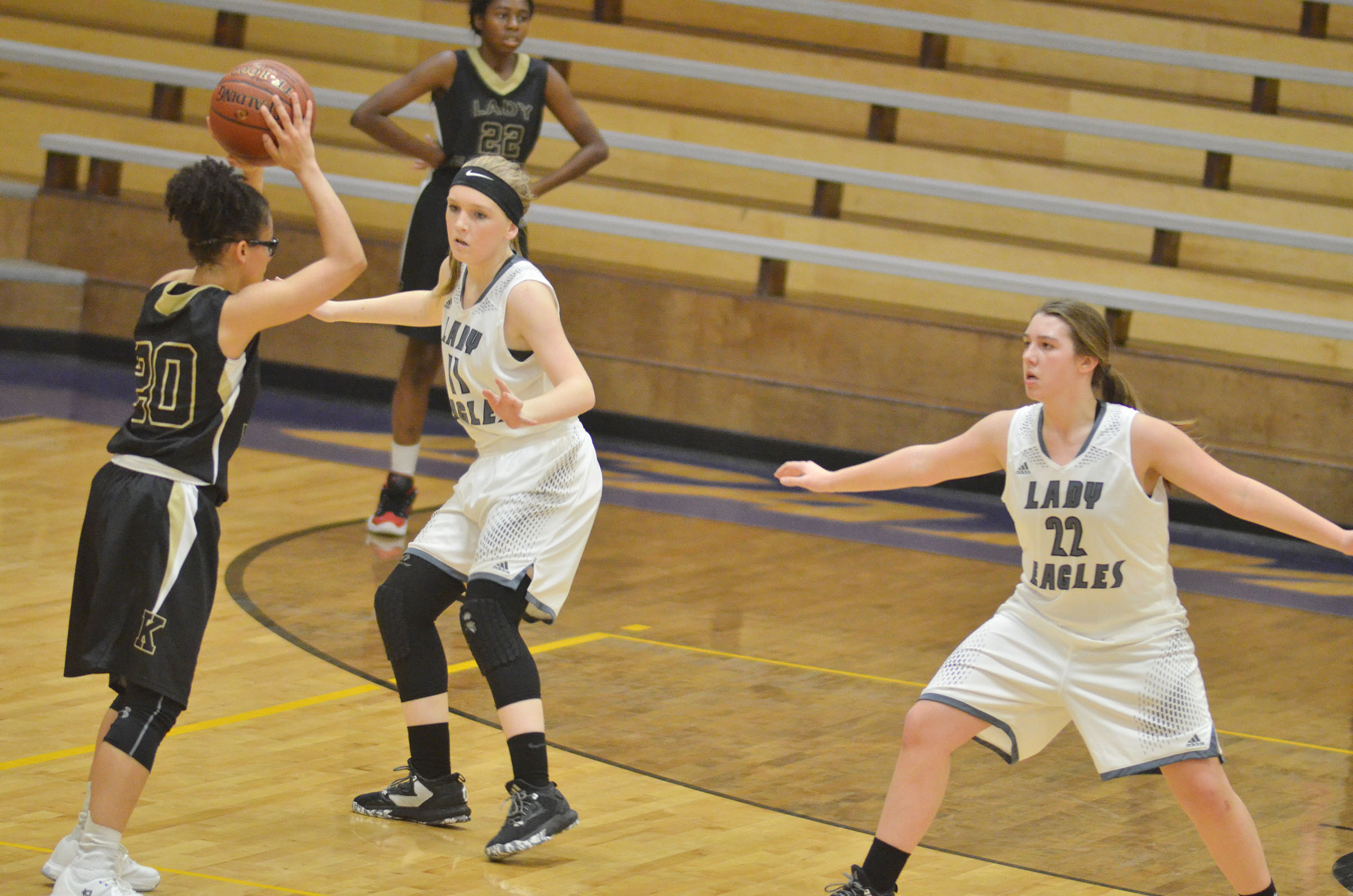 Campbellsville Middle School eighth-graders Catlyn Clausen, at left, and Abi Wiedewitsch play defense.