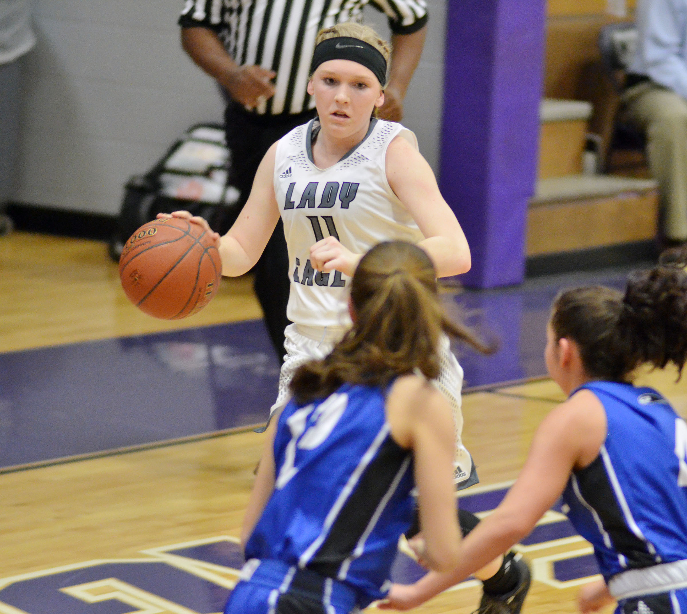 Campbellsville Middle School eighth-grader Catlyn Clausen sets up a play.