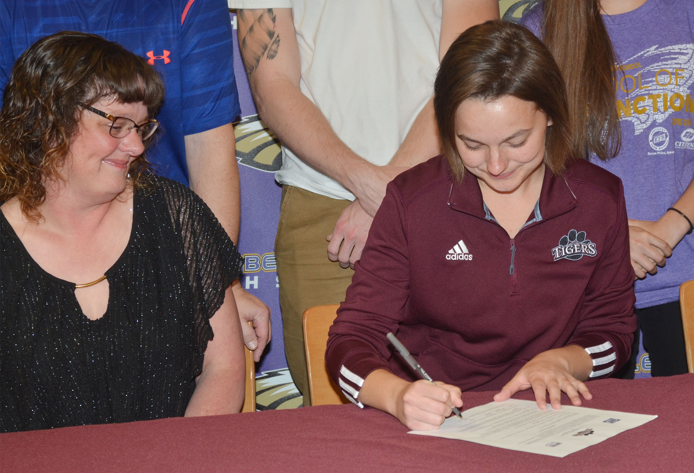 Campbellsville High School senior Kyrsten Hill will continue her academic and tennis career at Campbellsville University this fall. She recently signed her letter of intent in a special ceremony with her family, including her mother, Tonya, at left, her friends, teammates and coaches.