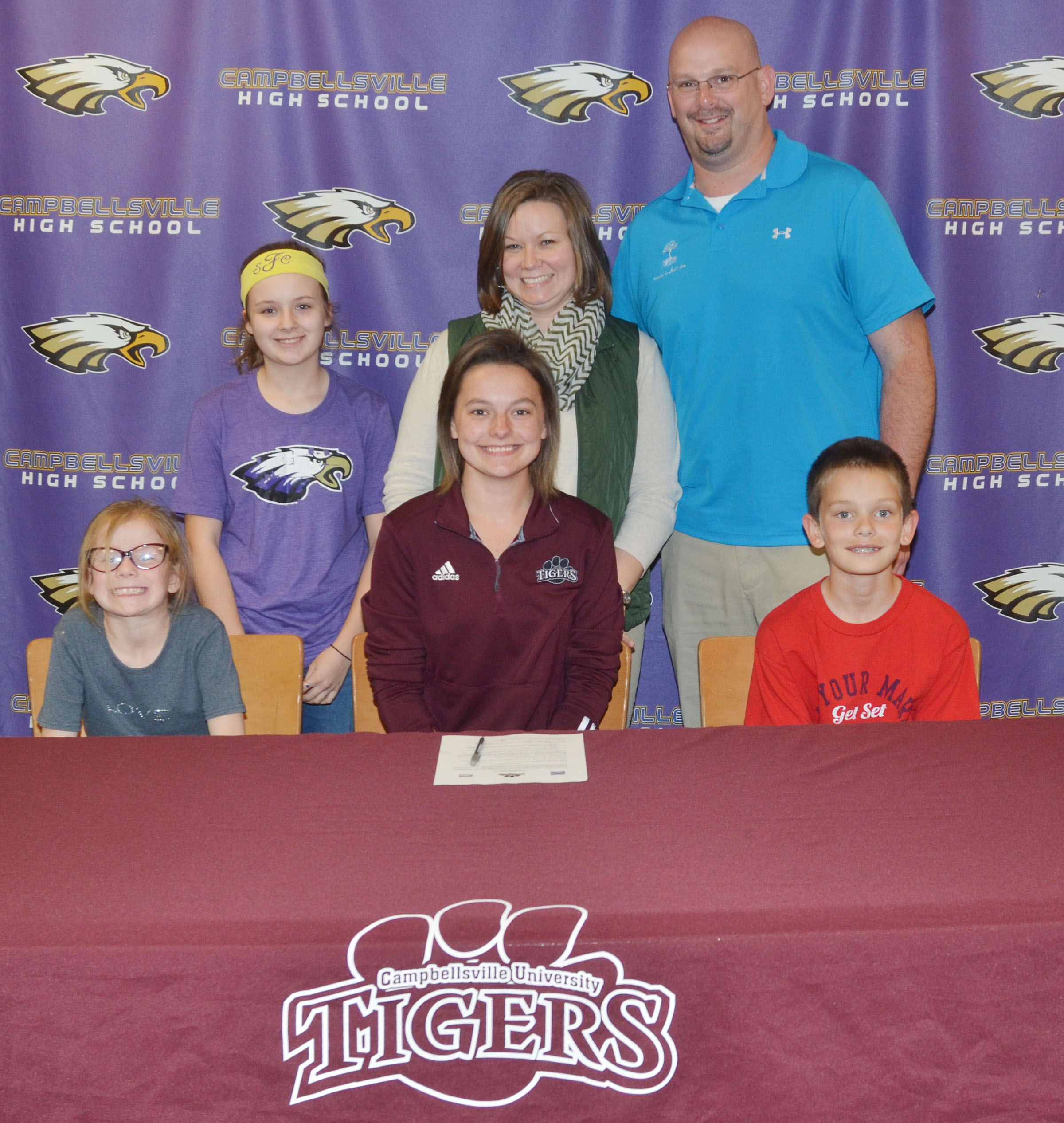 Campbellsville High School senior Kyrsten Hill will continue her academic and tennis career at Campbellsville University this fall. She recently signed her letter of intent in a special ceremony with her family, friends, teammates and coaches. Hill is pictured with her aunt and uncle, Kari and Rodney Booe, and their children, from left, Lizzie Booe, Campbellsville Middle School seventh-grader Serenity Ford and Grayson Booe.