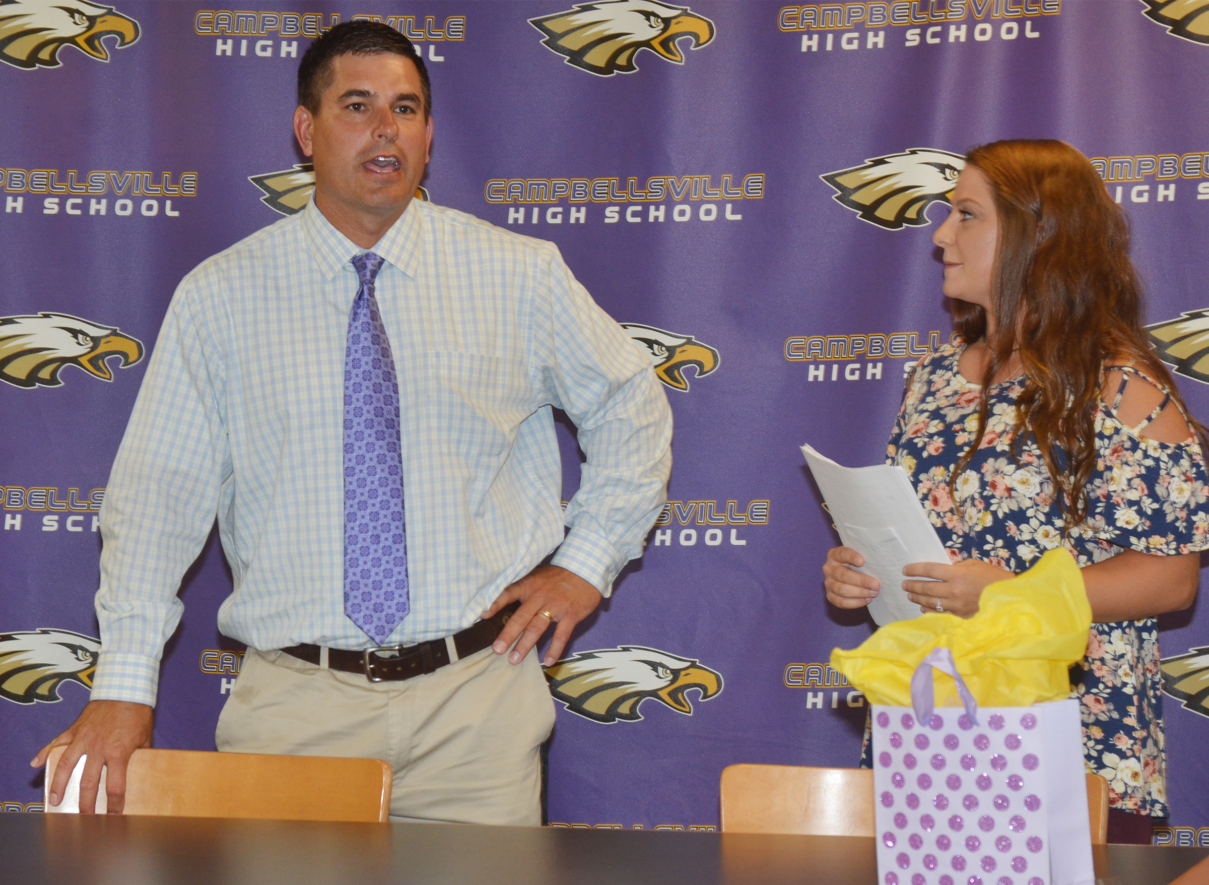 CHS Principal Kirby Smith introduces Cassidy Scantland as the new boys' golf coach.