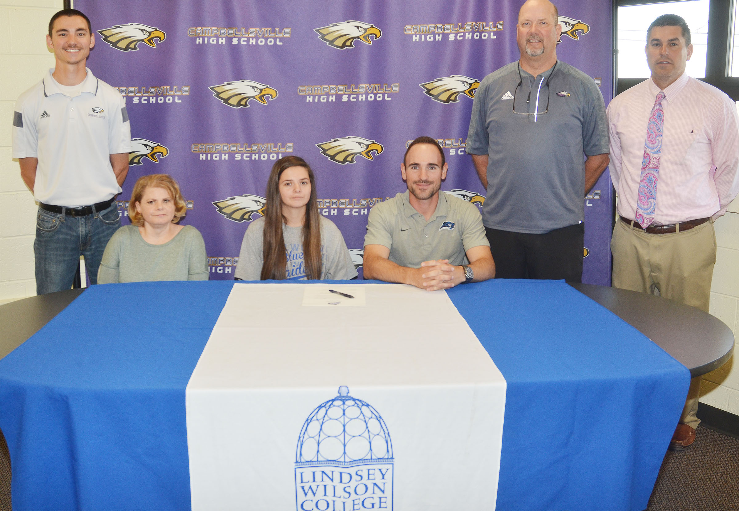 Campbellsville High School senior Shauna Jones will continue her academic and tennis career at Lindsey Wilson College this fall. Attending her signing ceremony are, from left, CHS tennis coach Bradley Harris, her mother Dana Pearl, Shauna, LWC head tennis coach Marlon Dal Pont, CHS Athletic Director Tim Davis and CHS Principal Kirby Smith.