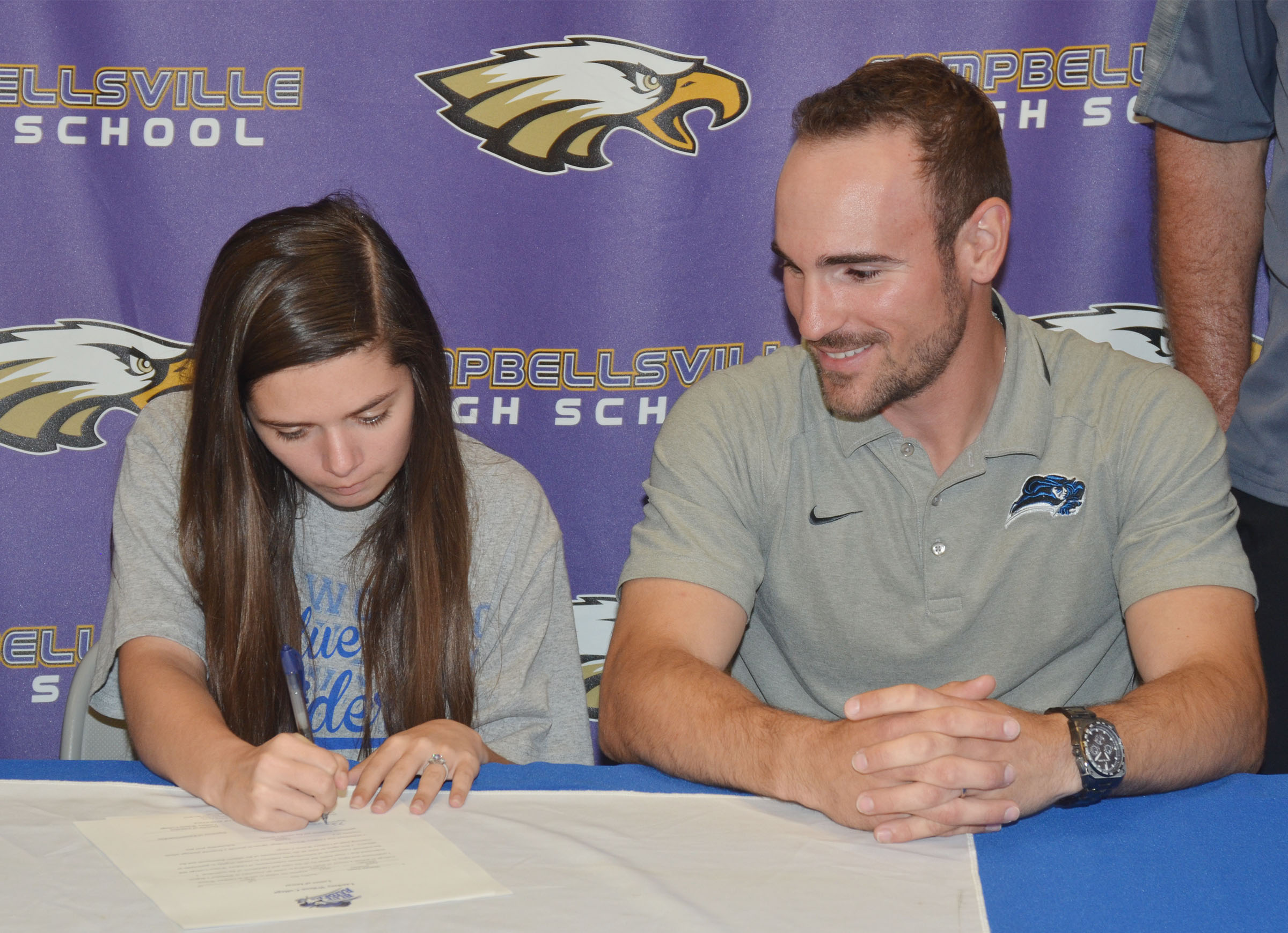 Campbellsville High School senior Shauna Jones will continue her academic and tennis career at Lindsey Wilson College this fall. Above, she signs her letter of intent with LWC head tennis coach Marlon Dal Pont.