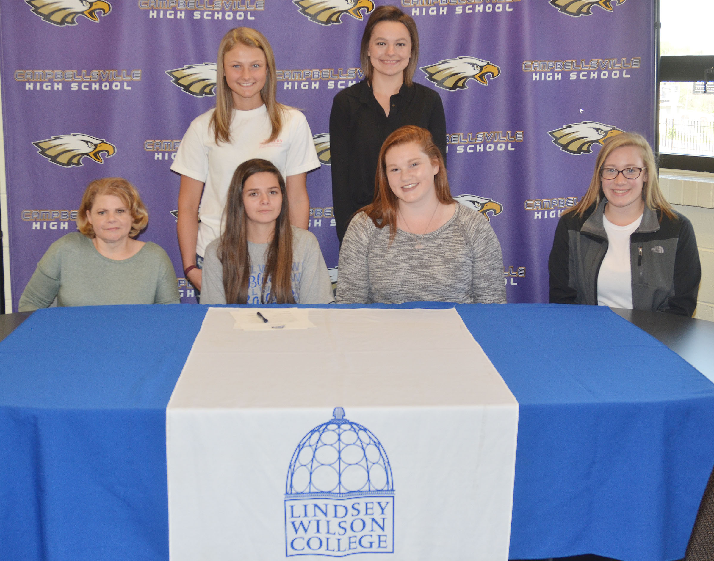 Campbellsville High School senior Shauna Jones will continue her academic and tennis career at Lindsey Wilson College this fall. Pictured with her are, from left, front, her mother Dana Pearl, Shauna, fellow senior tennis player Mallory Haley and freshman player Samantha Johnson. Back, freshman player Victoria Cox and fellow senior Kyrsten Hill.