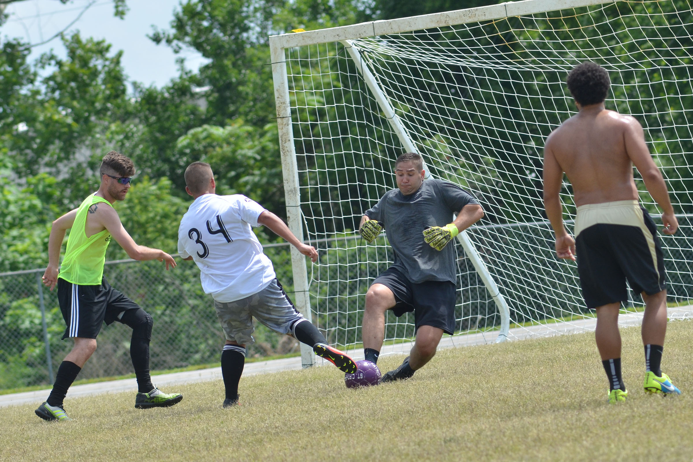 "CHS soccer alumni player Lincoln ""Bubba"" Lawless blocks a goal attempt by senior Cody Davis."