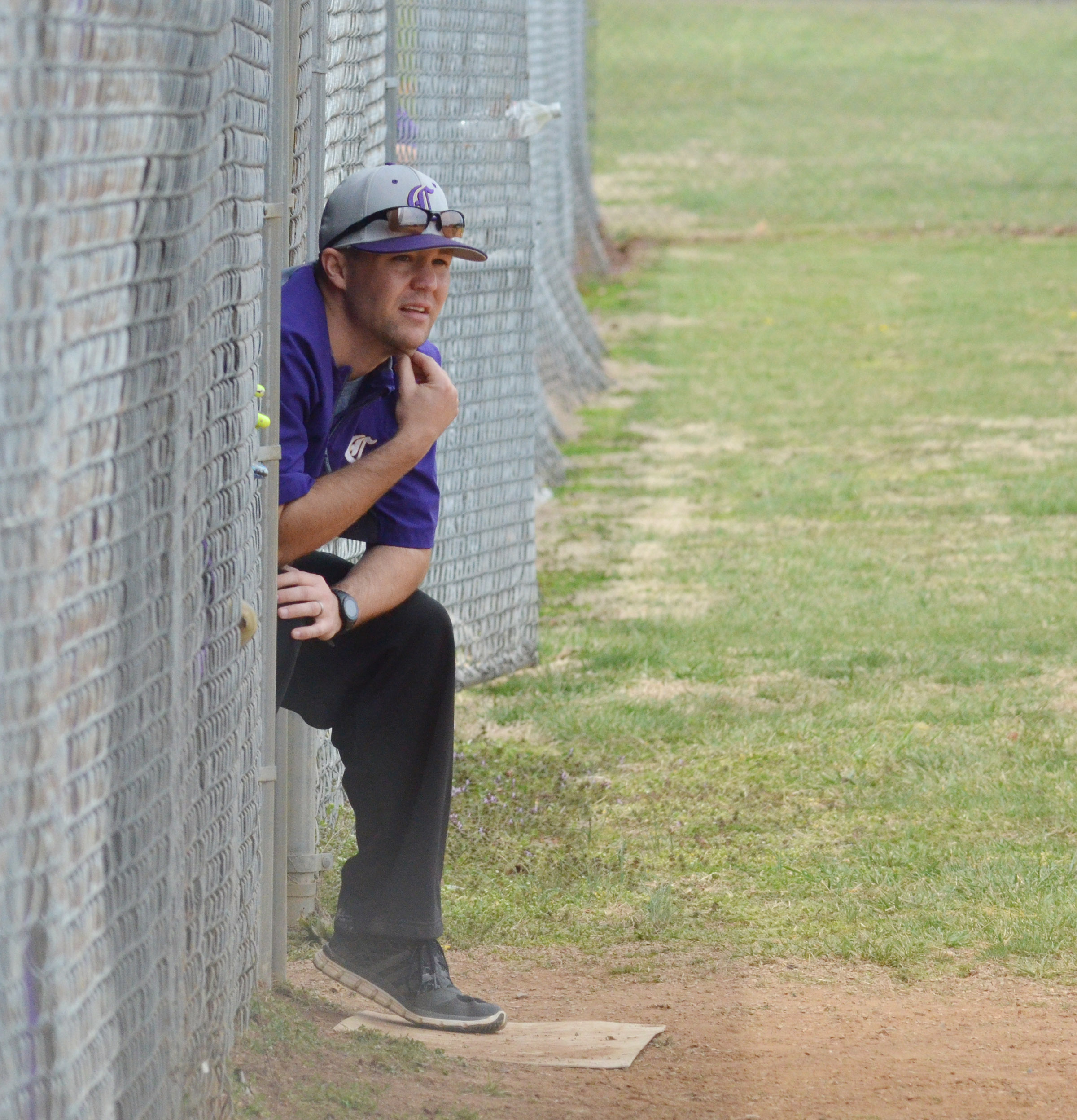 CHS head softball coach Weston Jones watches as his players take the field.