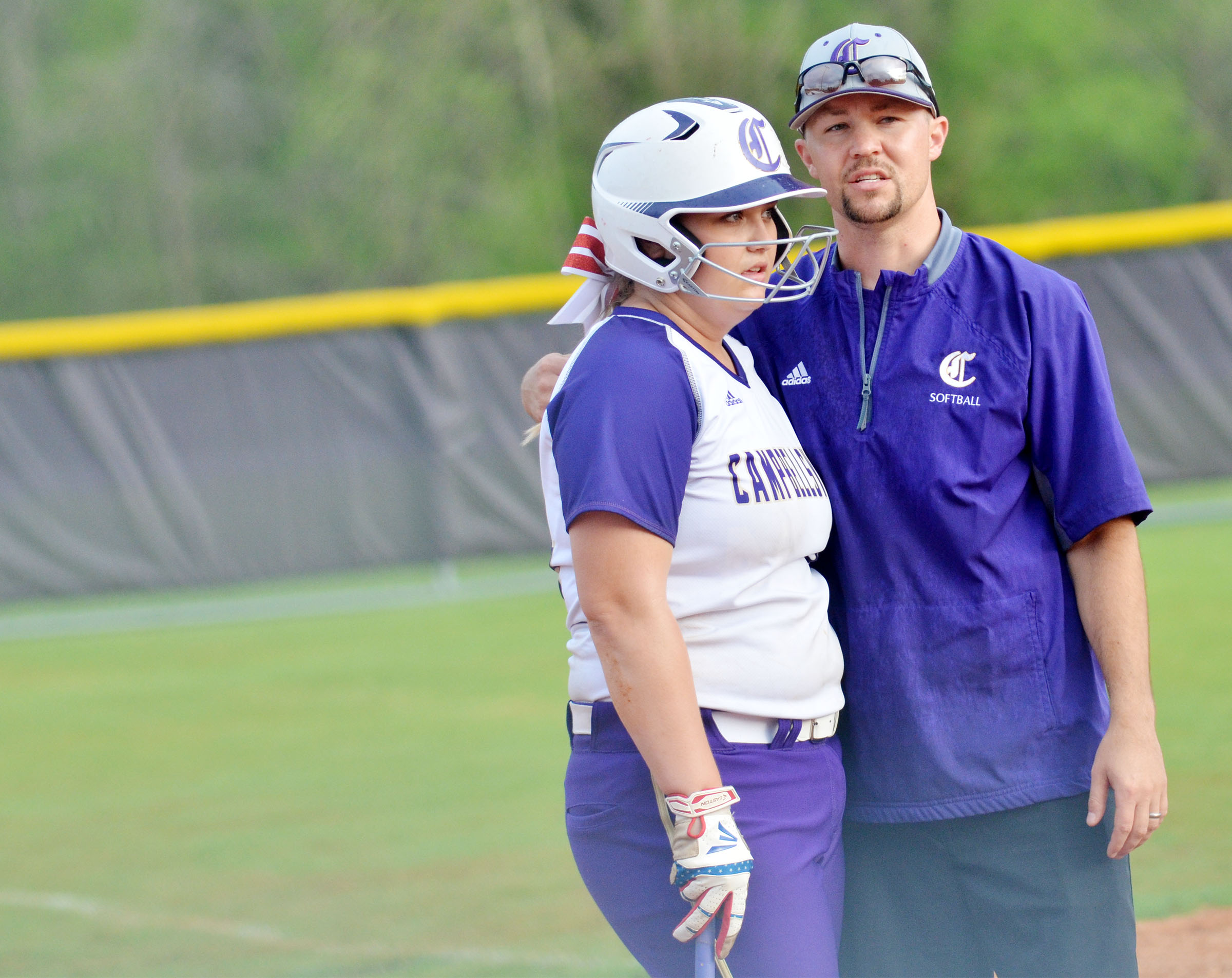 CHS head softball coach Weston Jones talks with senior Brenna Wethington before she bats.