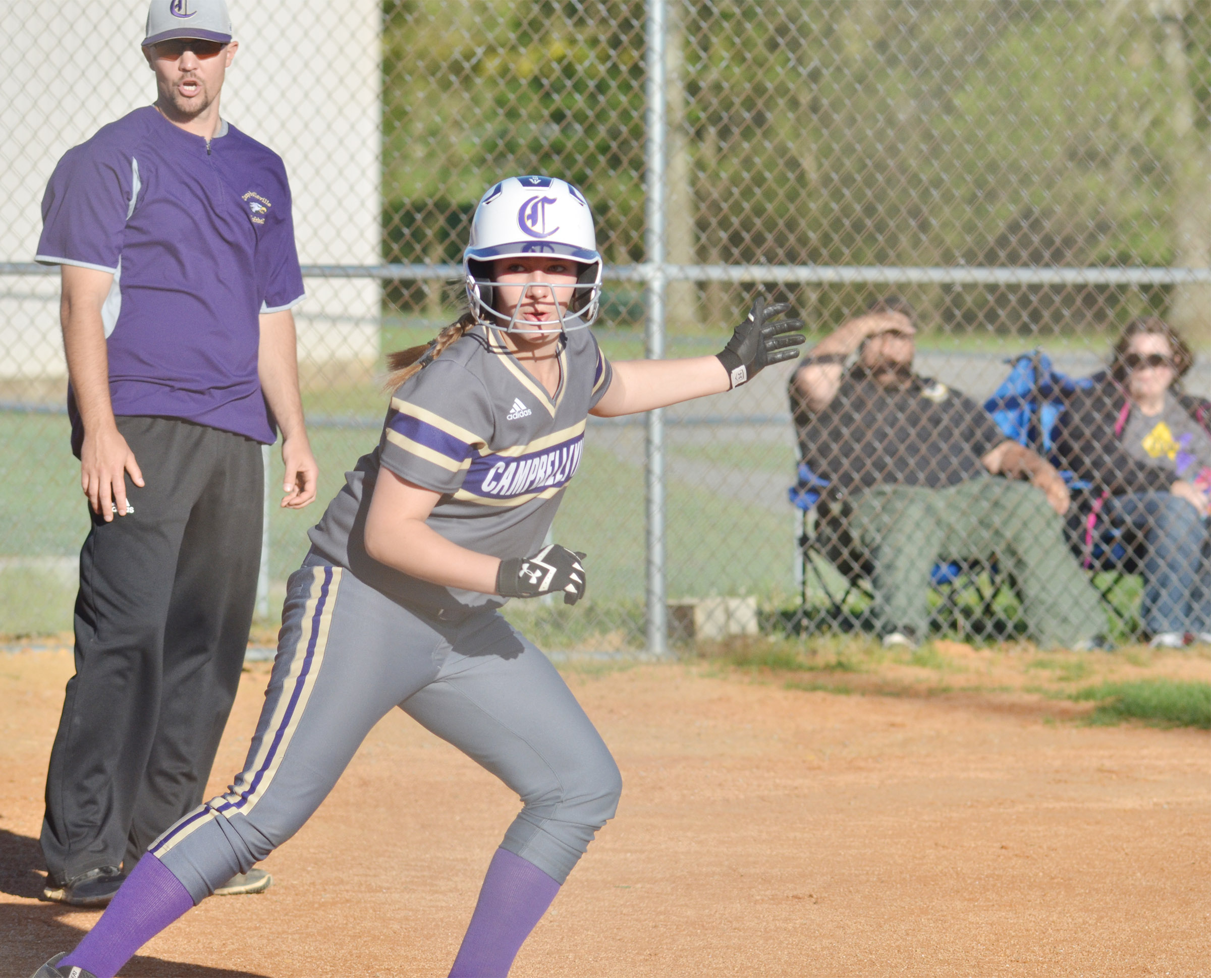 Campbellsville Middle School eighth-grader Abi Wiedewitsch heads back to third after Danville players try to get her out.