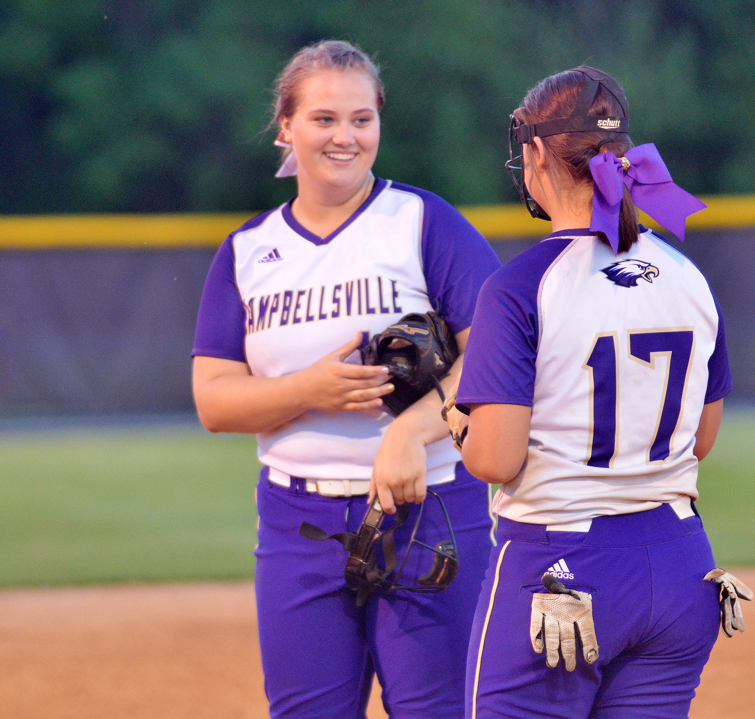 CHS seniors Brenna Wethington, at left, and Kailey Morris talk during an inning.