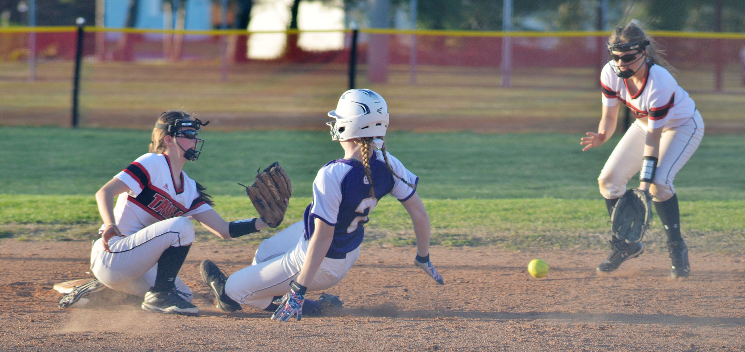 Campbellsville Middle School eighth-grader Catlyn Clausen slides into second.