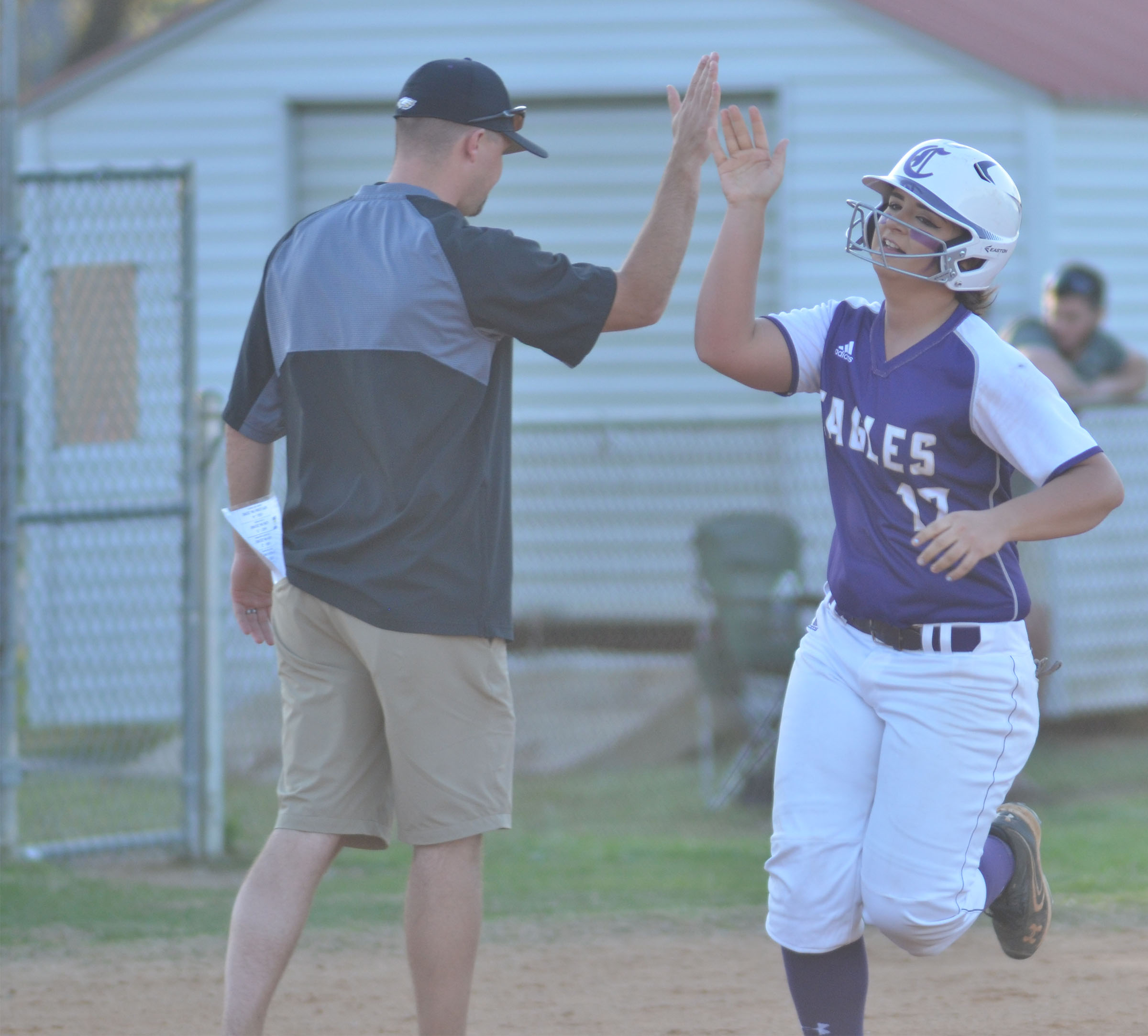 CHS senior Kailey Morris high-fives coach Weston Jones after hitting a three-run homerun.