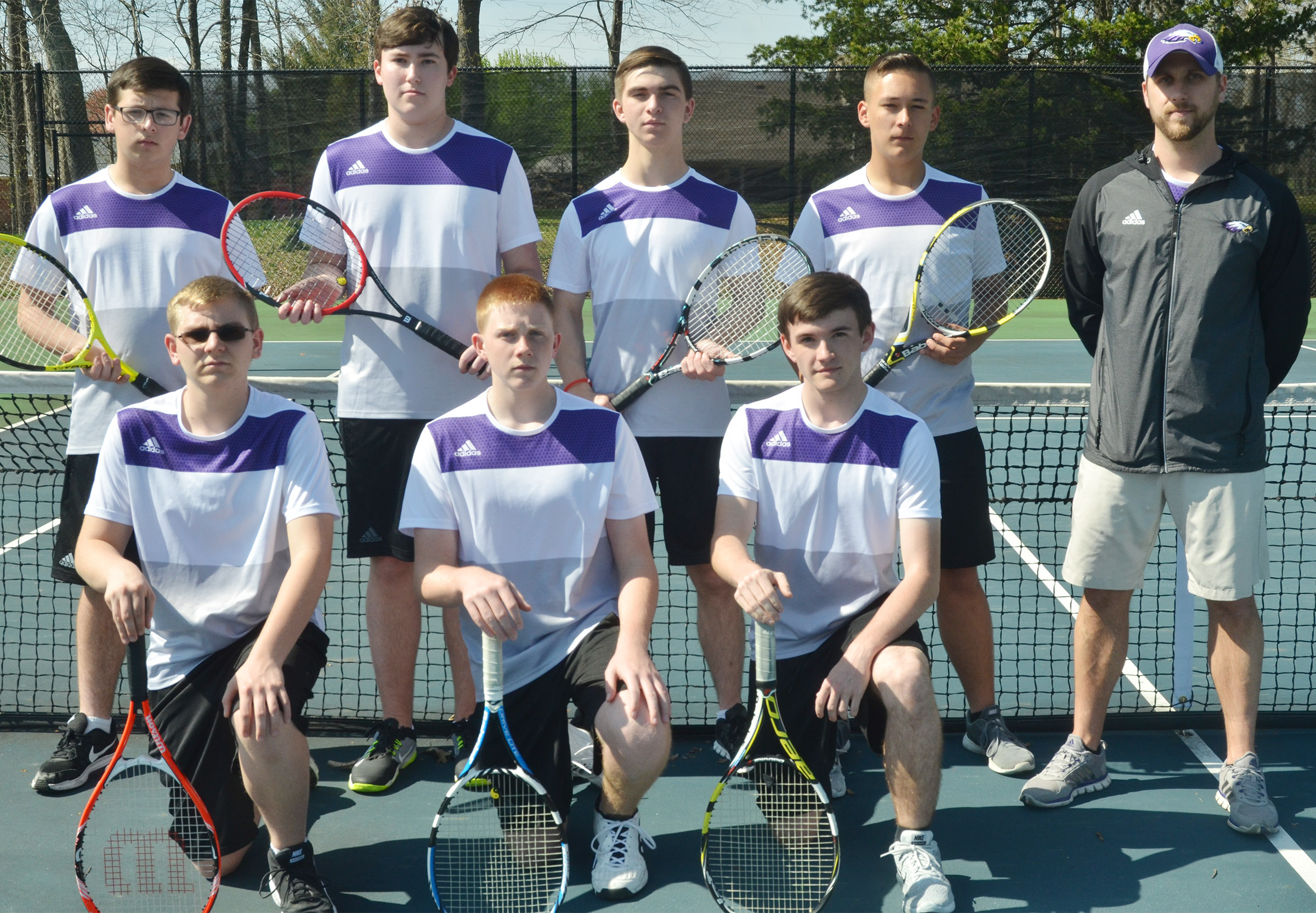 This year's CHS boys' tennis team is, from left, front, sophomore Brandon Greer, freshman Patrick Walker and junior Jackson Hunt. Back, Campbellsville Middle School eighth-grader Devan Keith, senior Zack Settle, juniors Cass Kidwell and Cody Davis and coach Tyler Hardy.