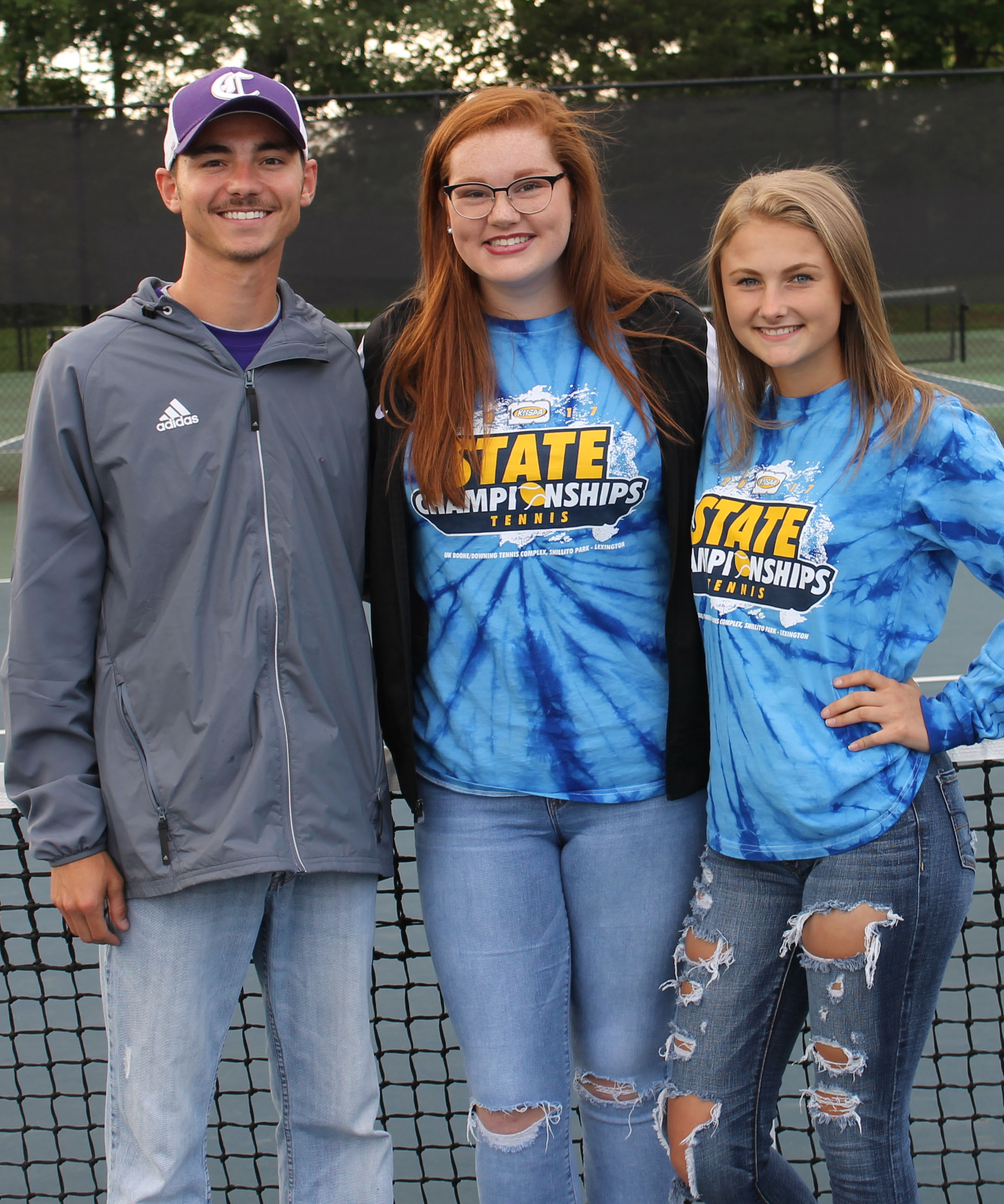 CHS girls' tennis coach Bradley Harris honors doubles partners Mallory Haley, center, who graduated in May, and freshman Victoria Cox for advancing to the Kentucky High School Athletic Association state tennis tournament.