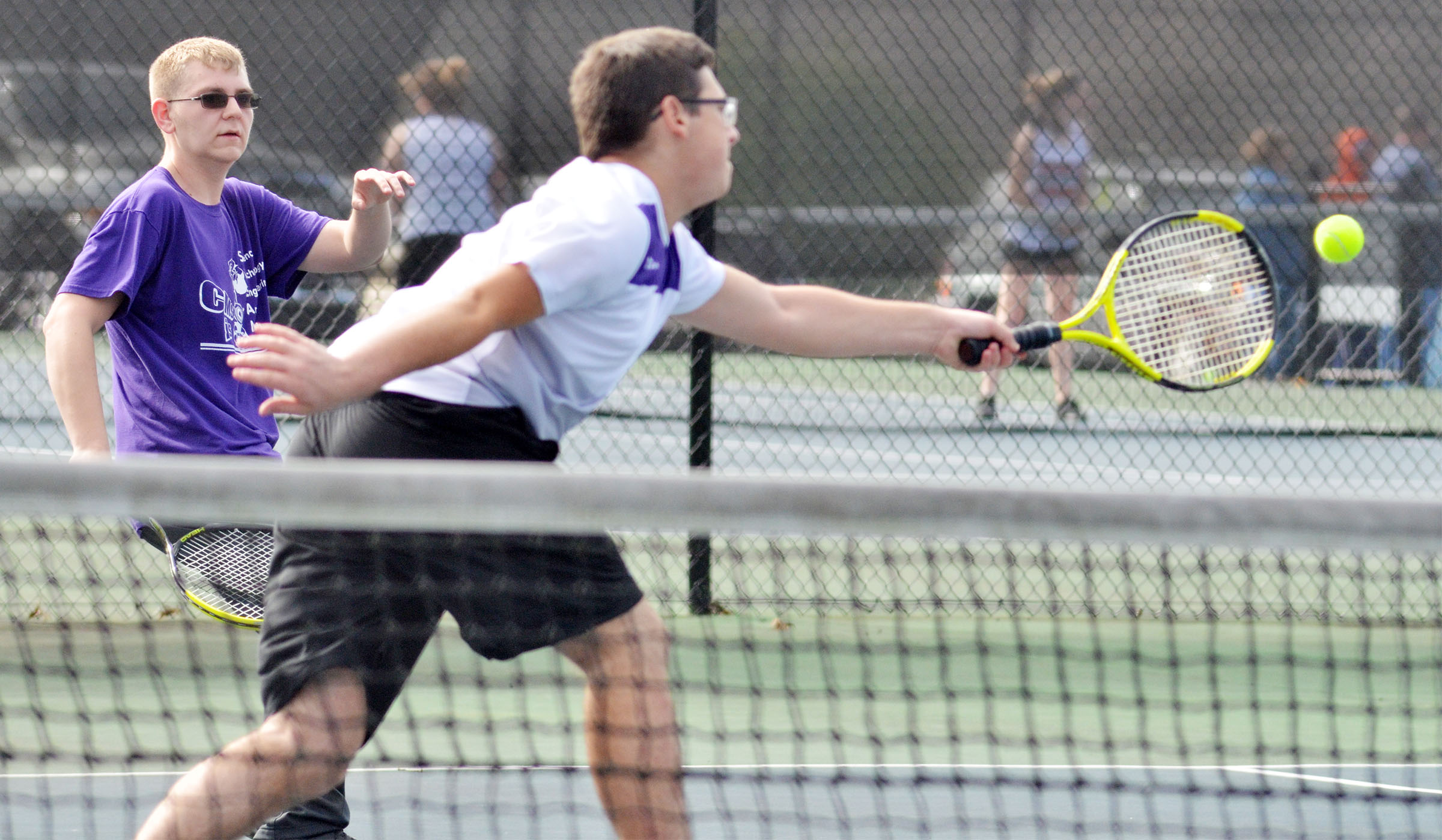 CHS sophomore Brandon Greer runs as his doubles partner Campbellsville Middle School eighth-grader Devan Keith hits the ball.