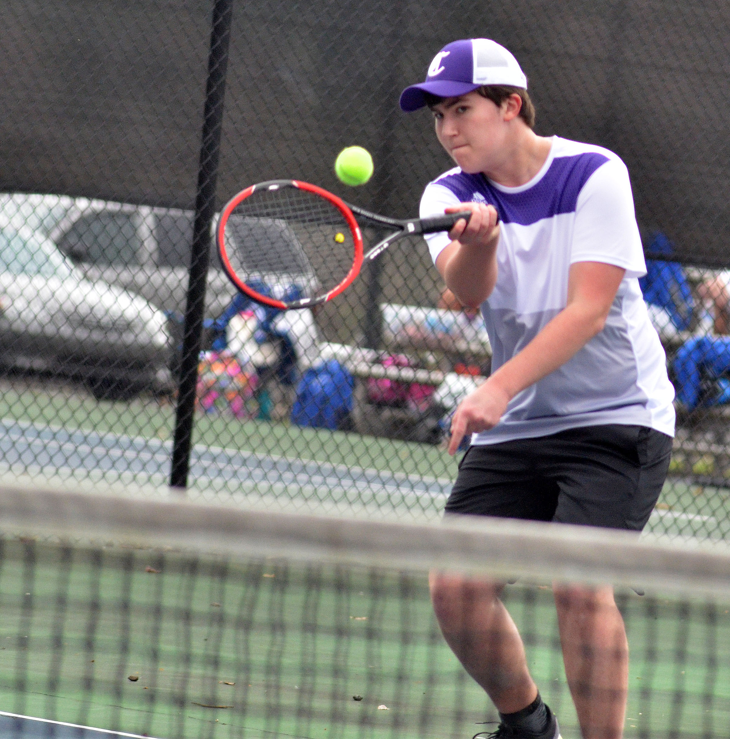 CHS senior Zack Settle hits the ball.