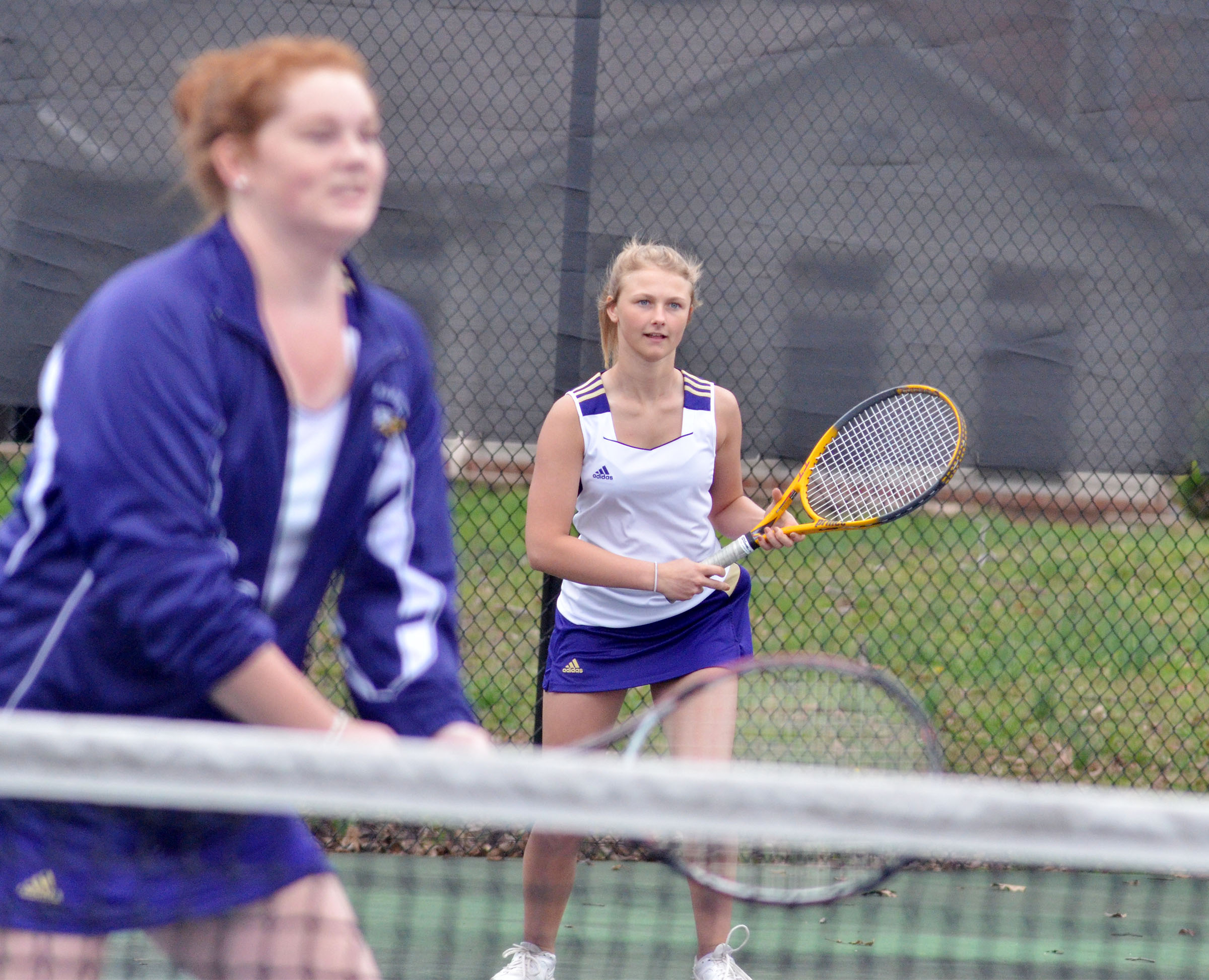 CHS freshman Victoria Cox keeps her eye on the ball as she plays a doubles match with senior Mallory Haley.