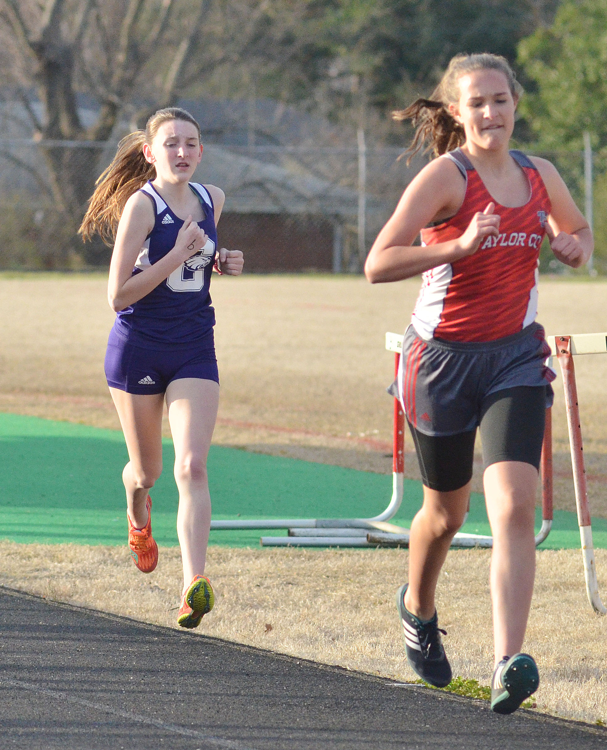 CHS freshman Zoe McAninch, at left, runs.