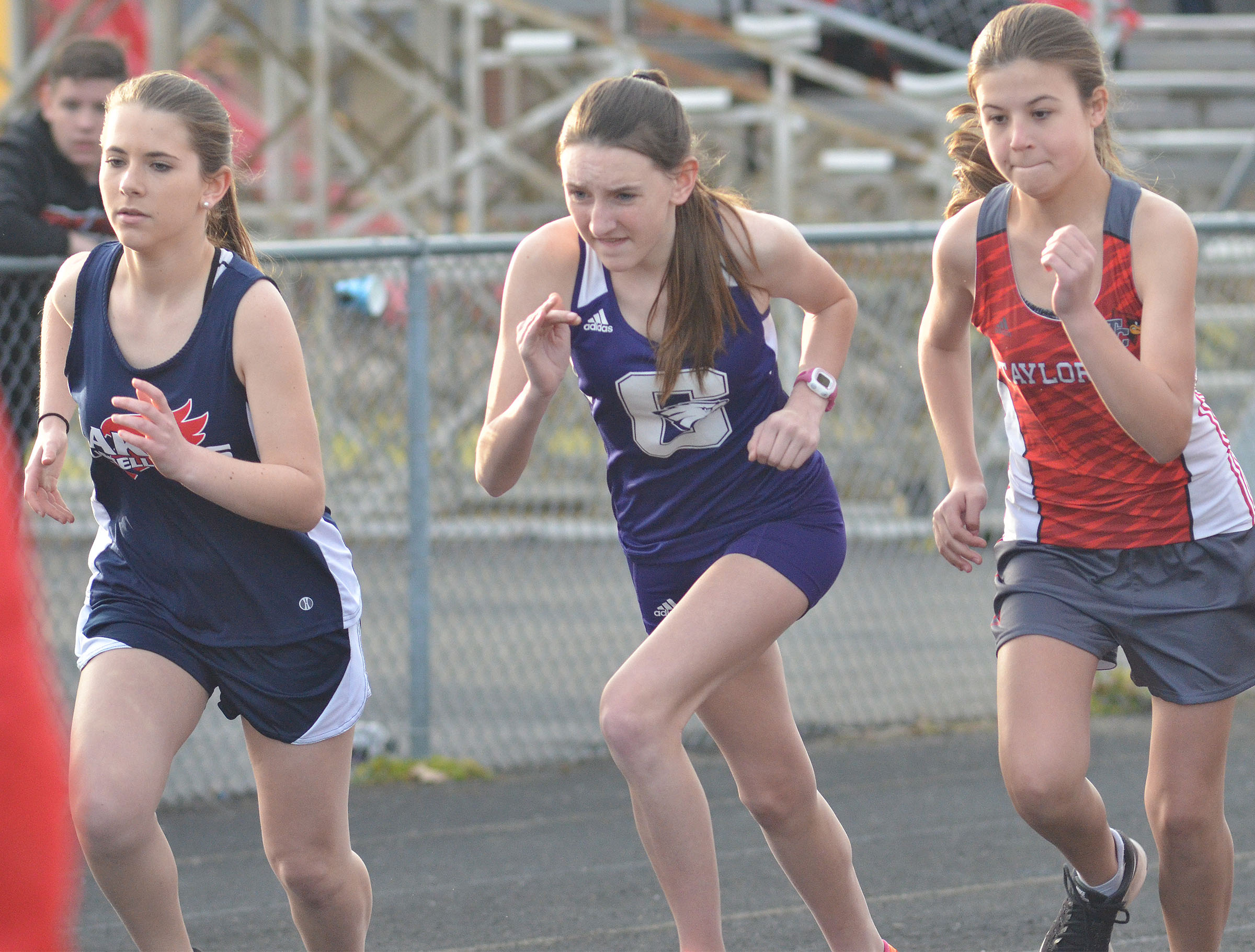 CHS freshman Zoe McAninch, center, runs.