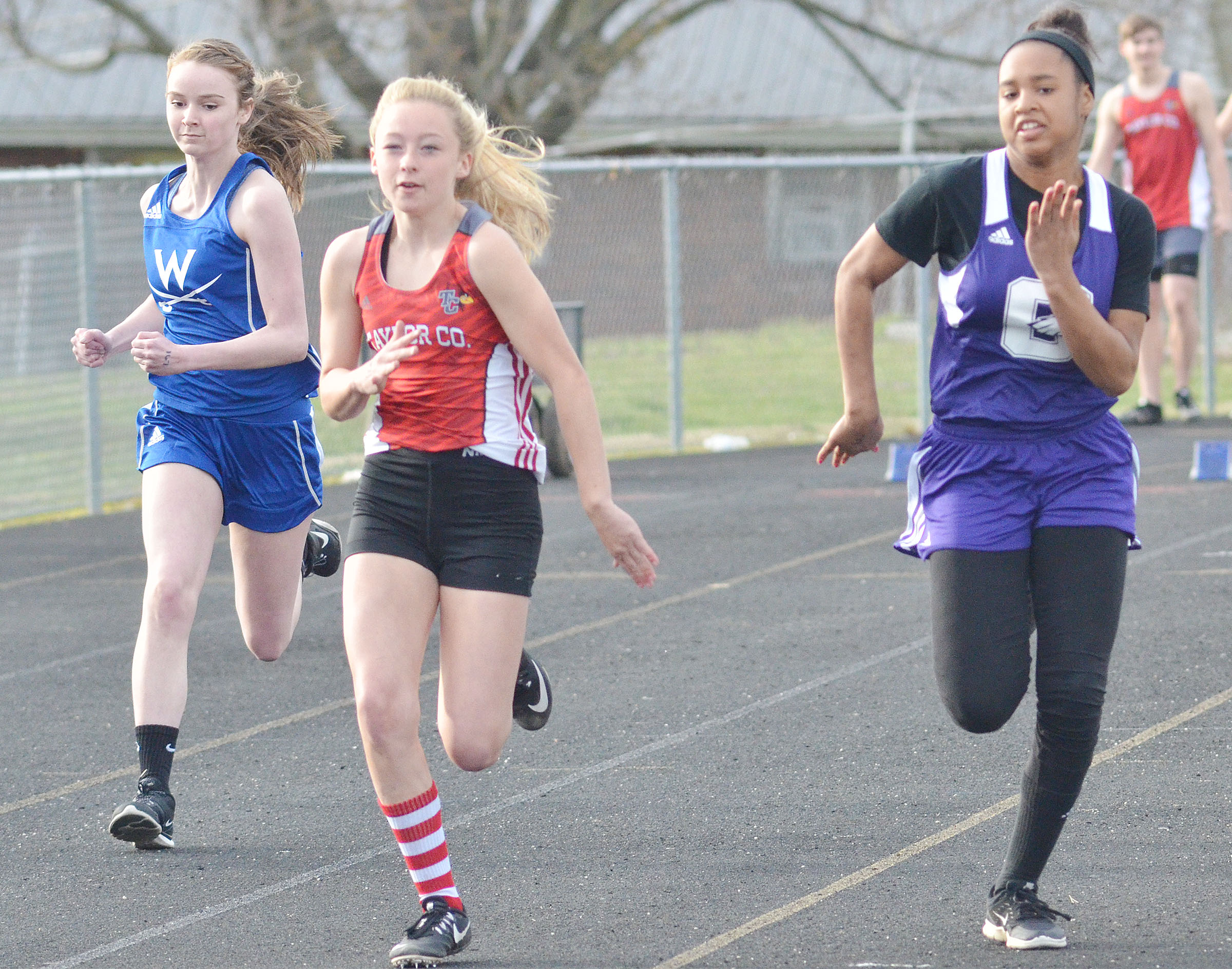CHS freshman Isis Coleman, at right, runs.