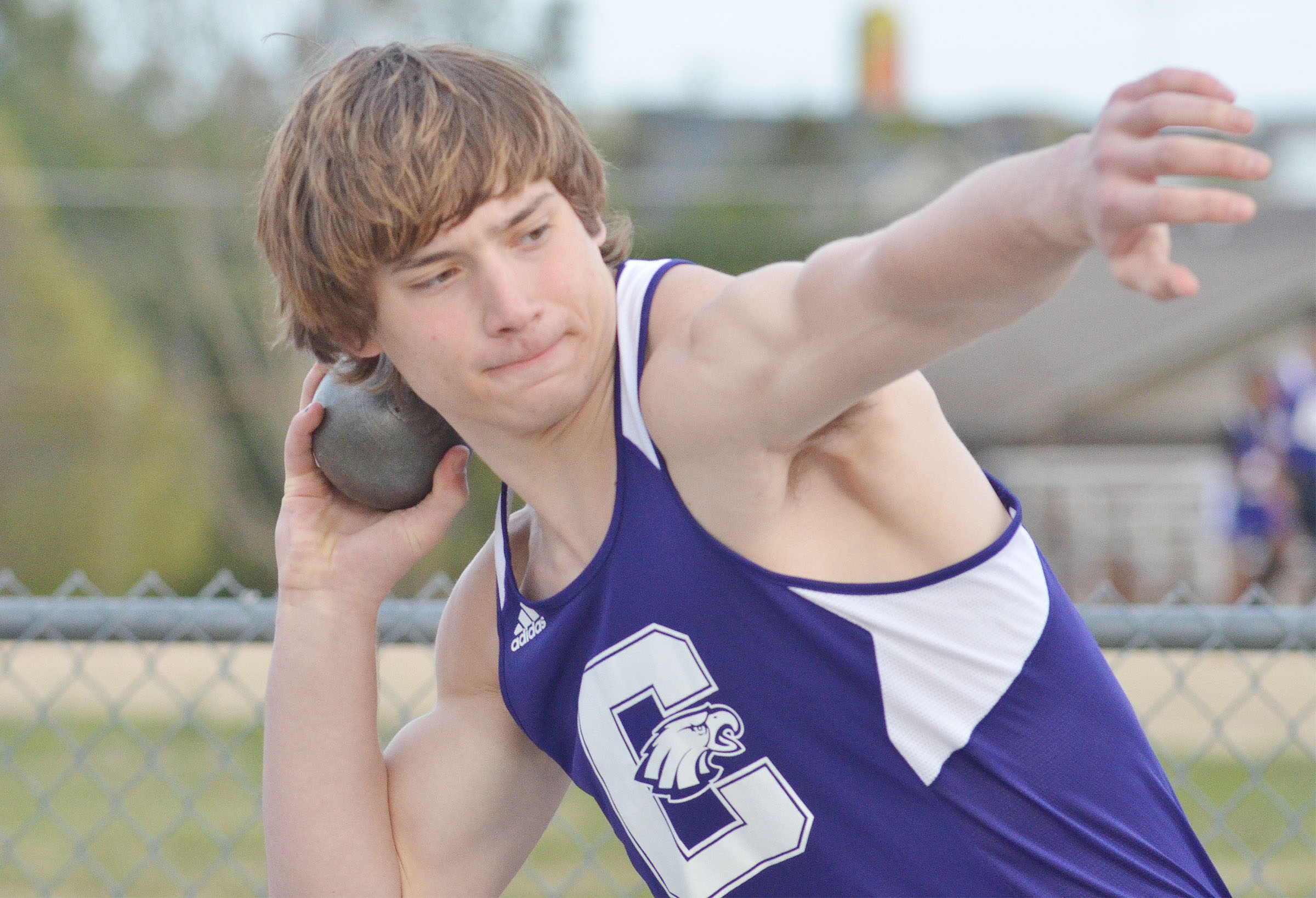 CHS sophomore Tristan Johnson throws shot put.